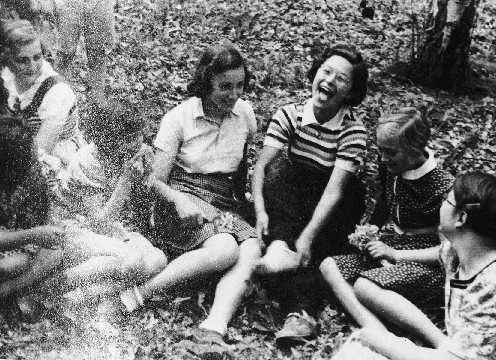 A group of girls enjoy a laugh on the grounds of Chateau de la Guette.  Gisela Edel is second from the right.