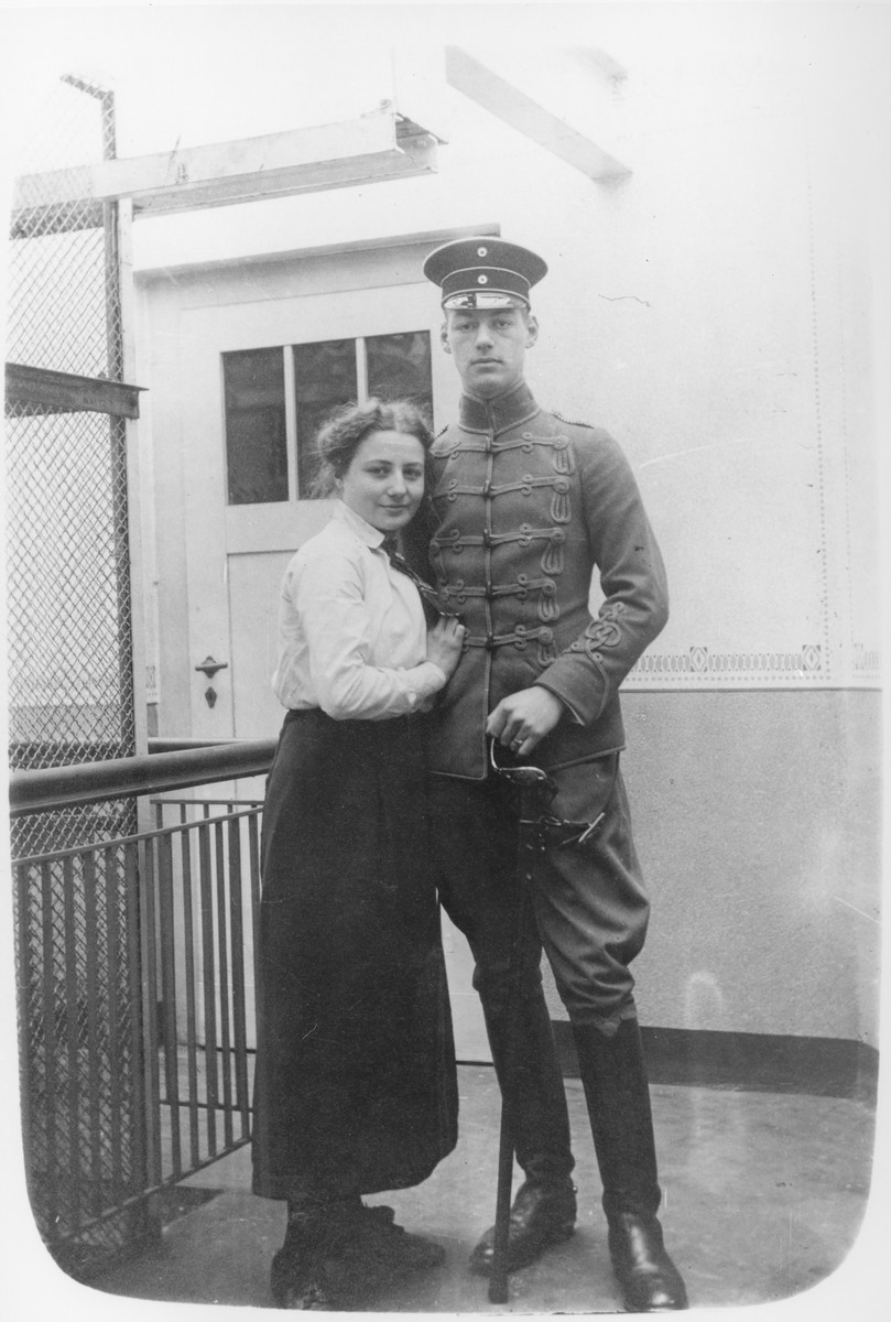 A Jewish soldier in the German army poses in uniform with his young wife.  Pictured are Hans and Trudi Oppenheim.
