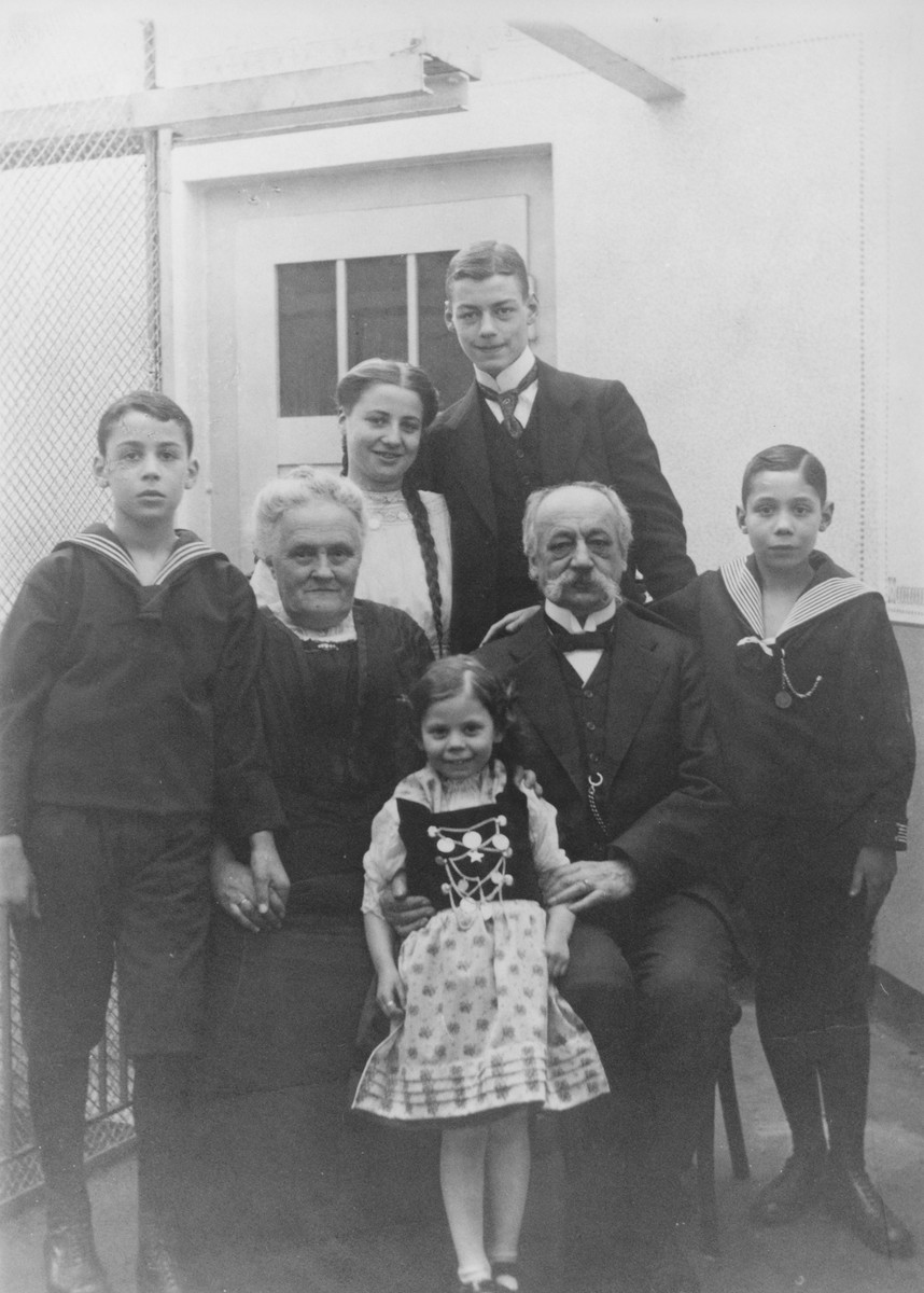 Group portrait of members of an extended Jewish family [probably in Kassel, Germany].  Among those pictured are Trudi Lindenfeld and Hans Oppenheim (top).  The young girl in the center is Gertrude Deutsch (later Meyer), who was hidden in Holland during the German occupation.
