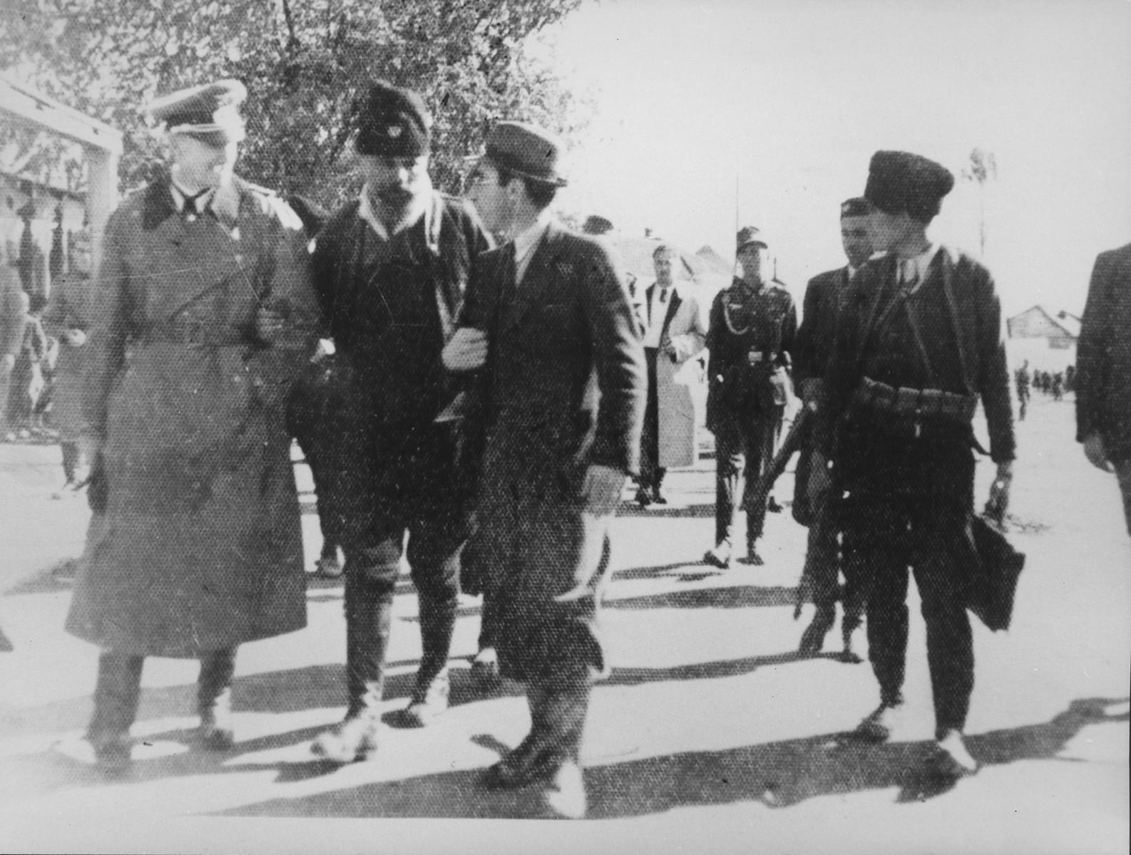 A German military officer converses with  Kosta Pecanac (the pre-war president of the Chetniks) and  Xhafer Deva (a collaborator from Kosovo) in Podujevo.