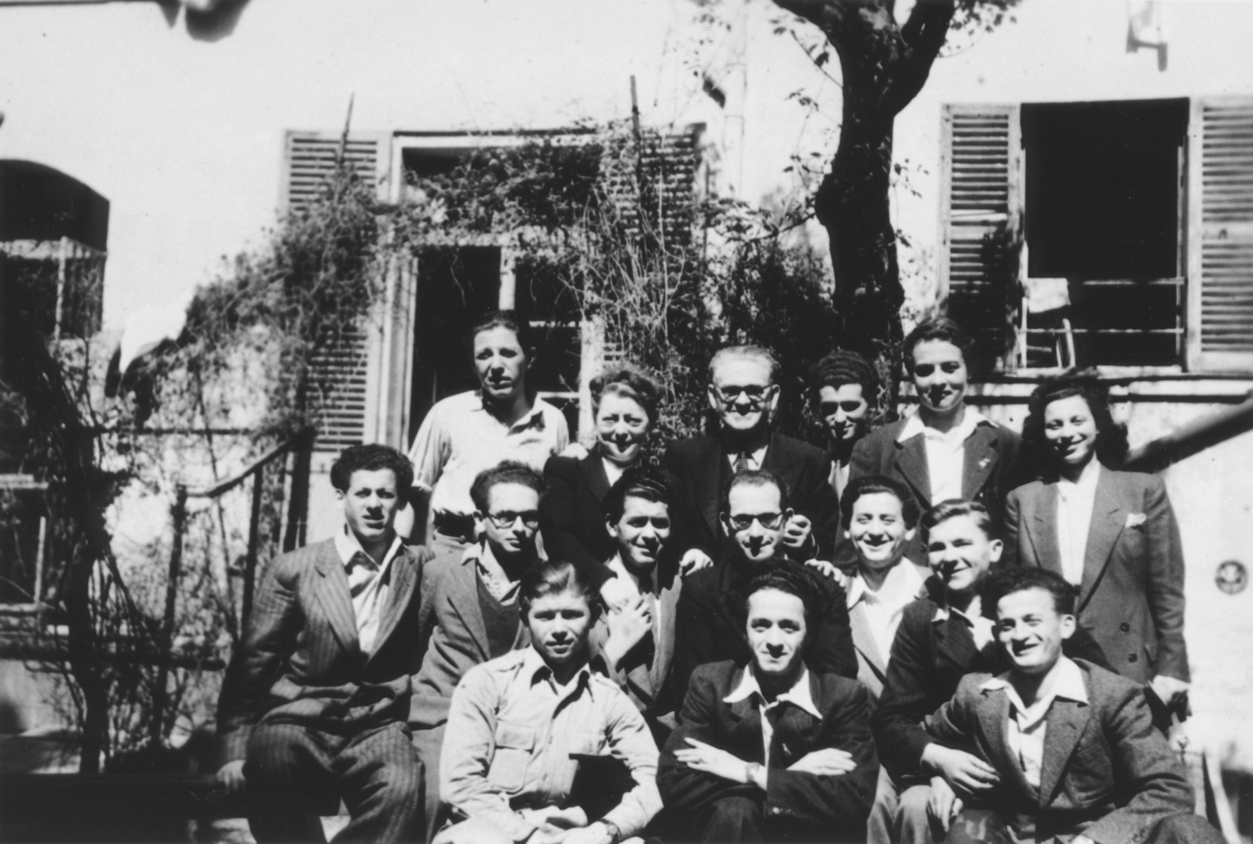 Group portrait of the staff and youth of the OSE children's home on the rue Rollin in Paris.  Pictured from left to right are: Front row: Joseph Magier, Gerson, Asher Greenberg.  Middle row: Lazer Greenberg, unidentified, Peretz Fogel, Joseph Szwarcberg and unidentified.  Top row: Willy Fogel, an elderly couple who brought food to the home, unidentified and Eddie Balter.