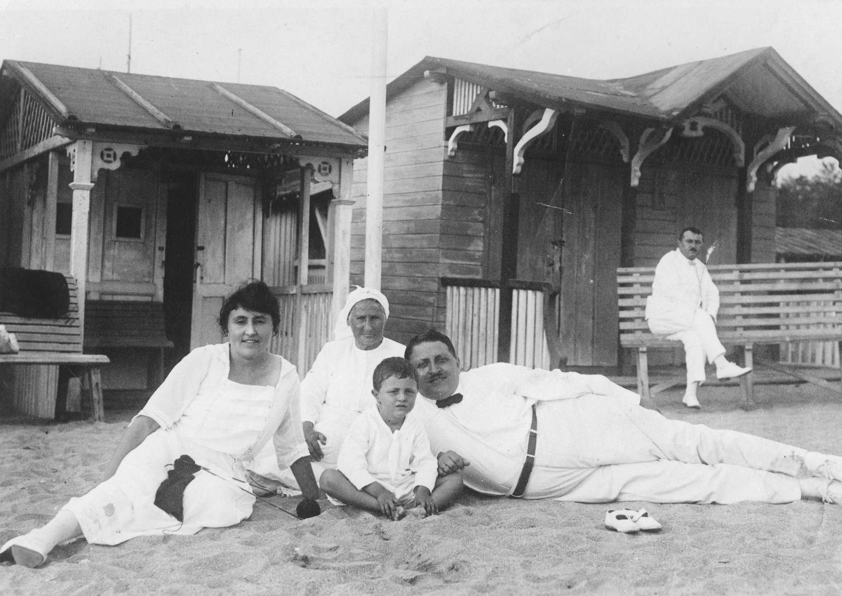 A Jewish family poses with their nurse on the beach at Tsin Tzo.  Pictured are Aaron and Betia Faingersch with their son Vladimir.