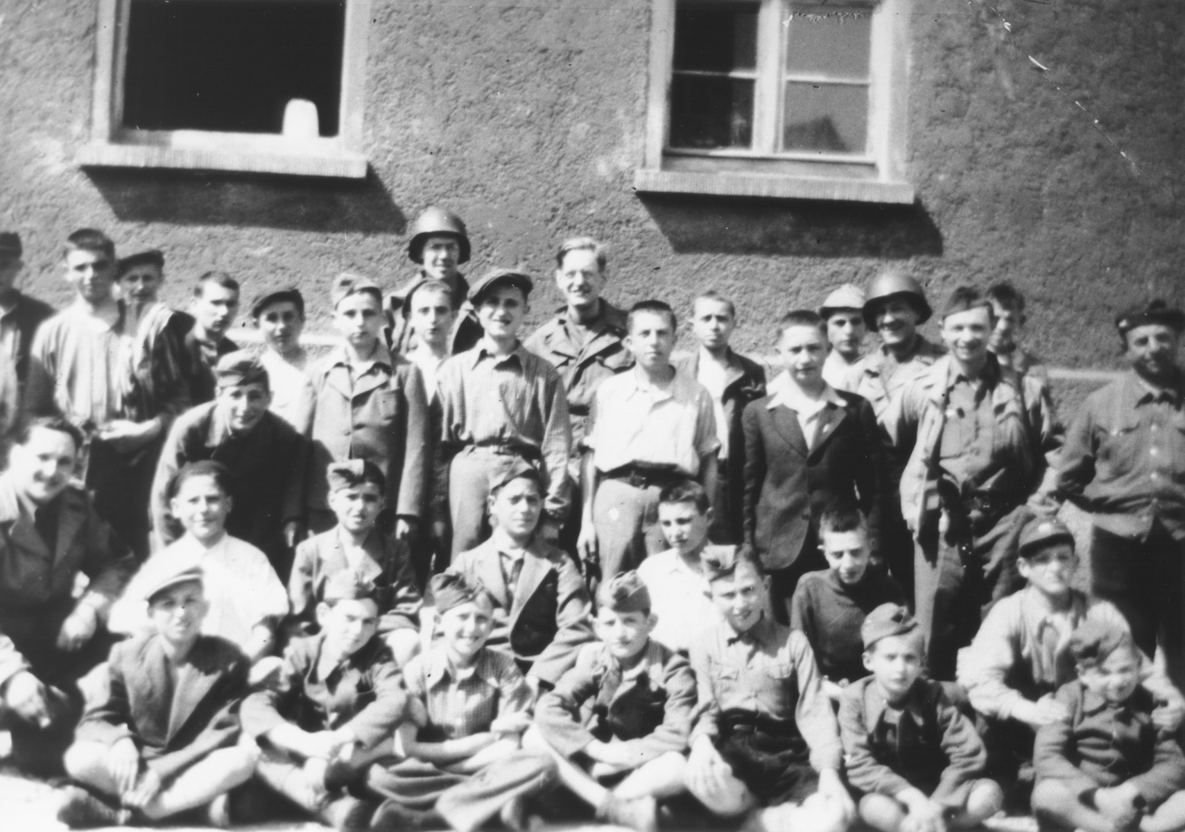 Group portrait of child survivors of Buchenwald taken outside a barracks prior to their departure for France and Switzerland.