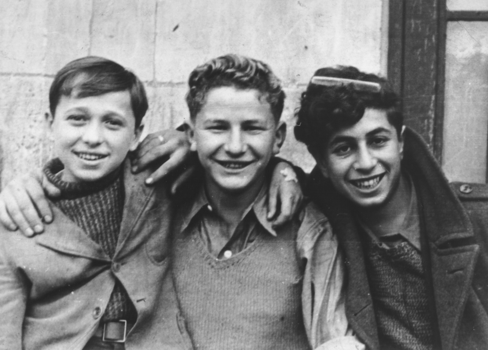 Portrait of three Jewish DP youth at the OSE (Oeuvre de Secours aux Enfants) children's home in Champigny-sur-Marne.   Pictured from left to right are: Leon Lewkowicz, Johny Weisz and Ignatz Spett.