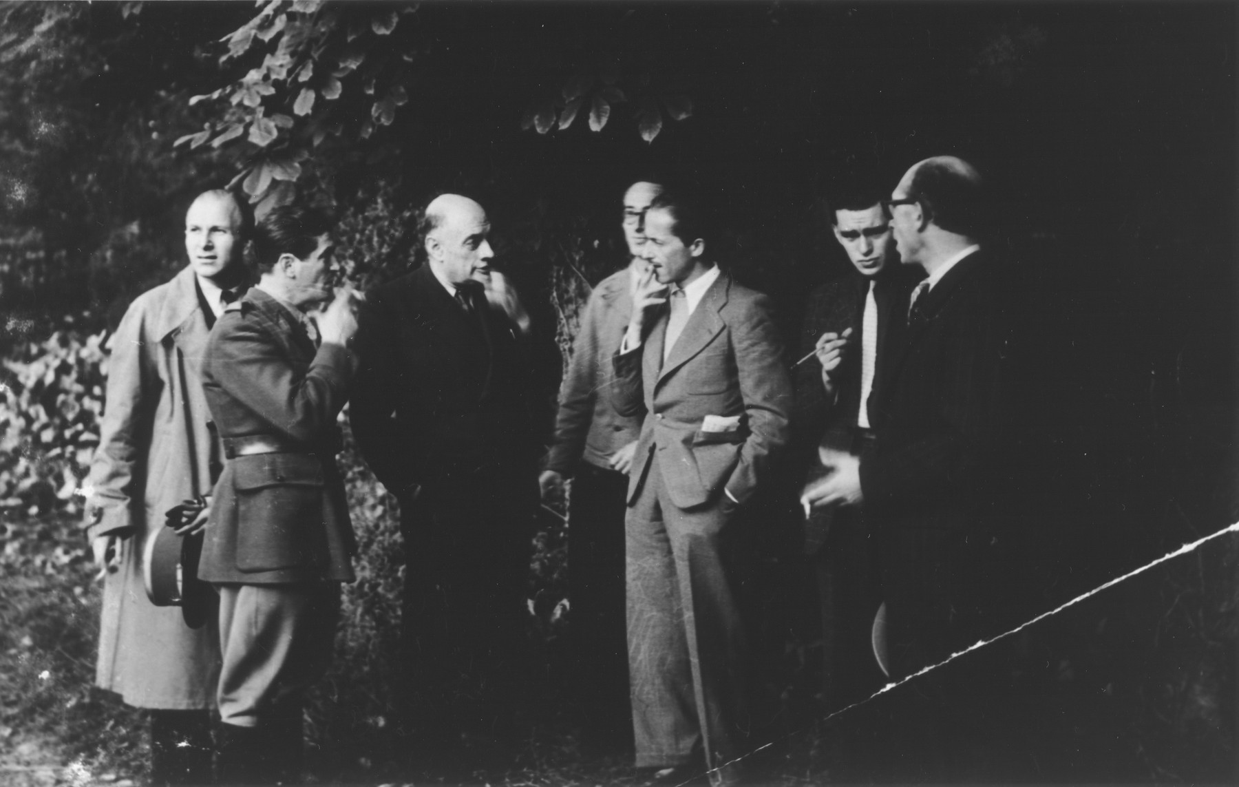 A group of OSE (Oeuvre de Secours aux Enfants) directors meet in the Ecouis children's home.  Among those pictured are: Georges Garel (center), M. Schifman (far left) and Captain Rozen (second from the left).
