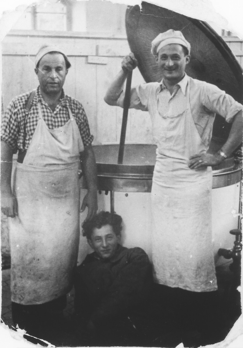 Zdenek Mermelstein (right) poses with fellow workers in the kitchen of the Gabersee displaced persons camp.