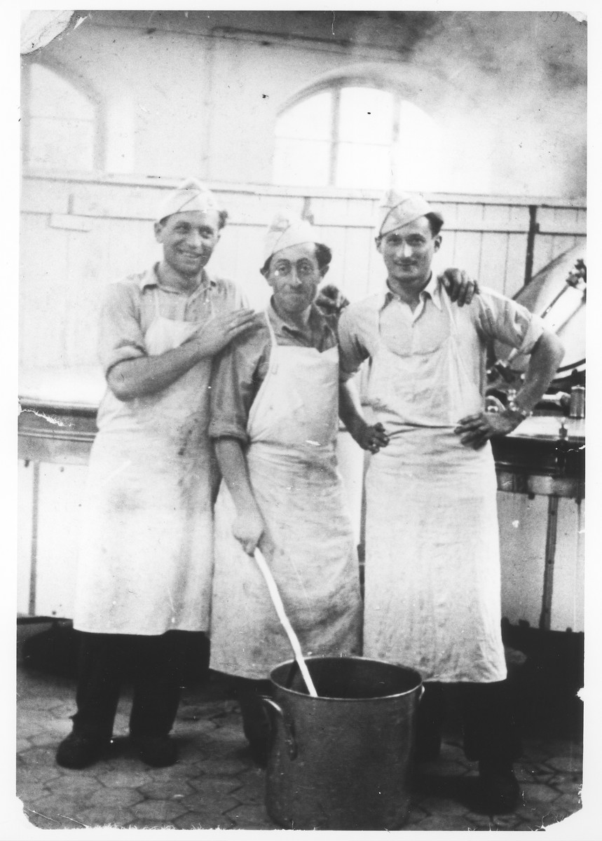 Zdenek Mermelstein (right) poses with two friends in the kitchen of the Gabersee displaced persons camp.