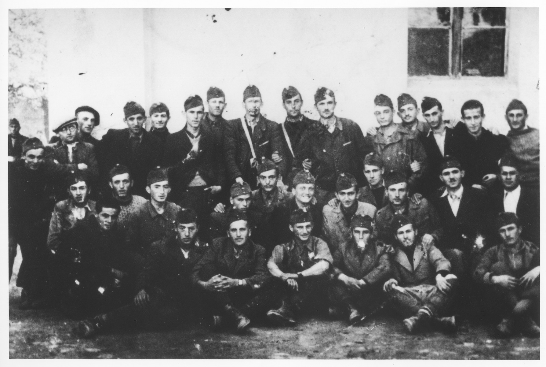 Group portrait of members of an Hungarian labor battalion in Baia-Mare (Nagybanya).