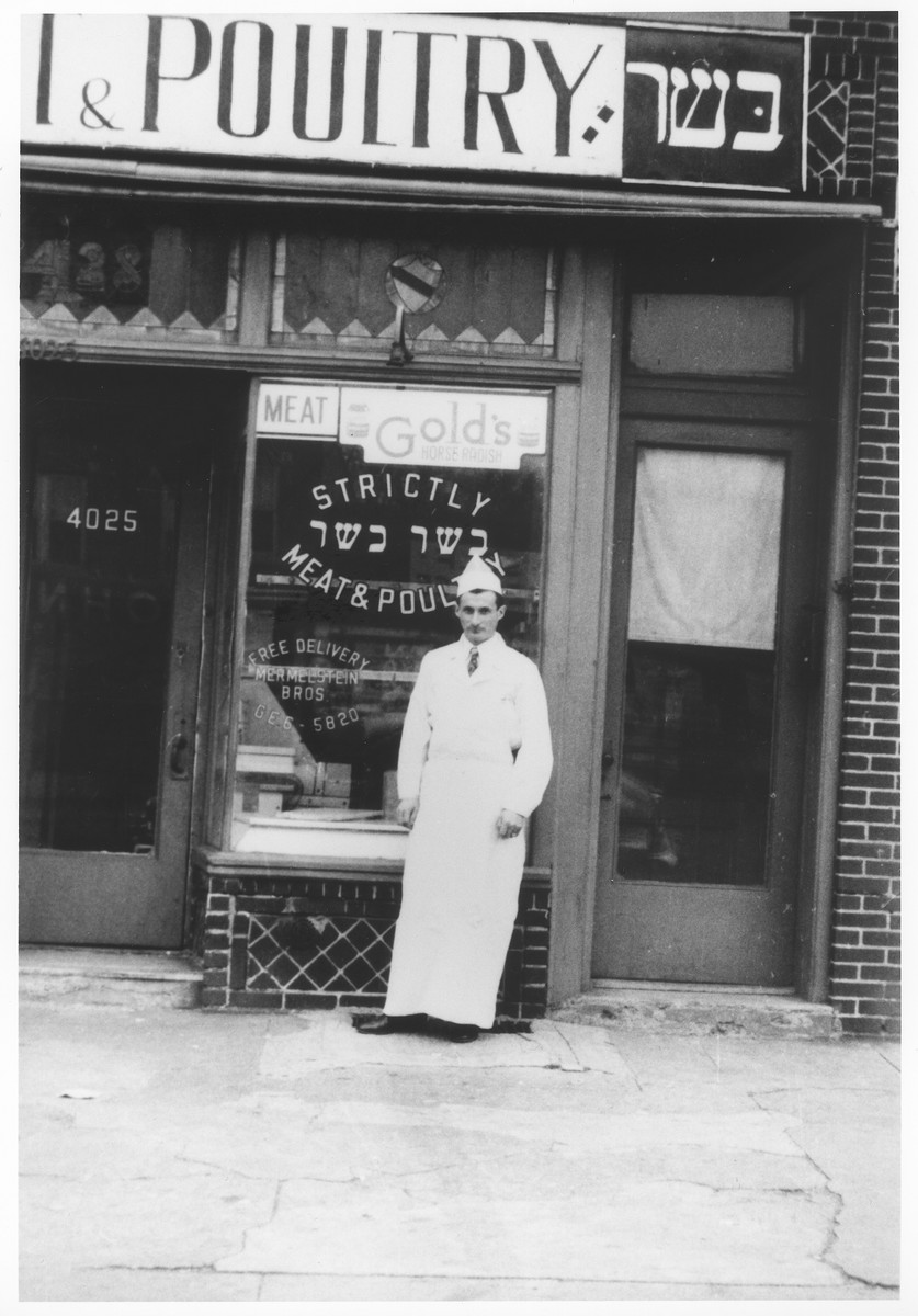 Zdenek Mermelstein stands in front of his kosher butcher shop in Brooklyn.