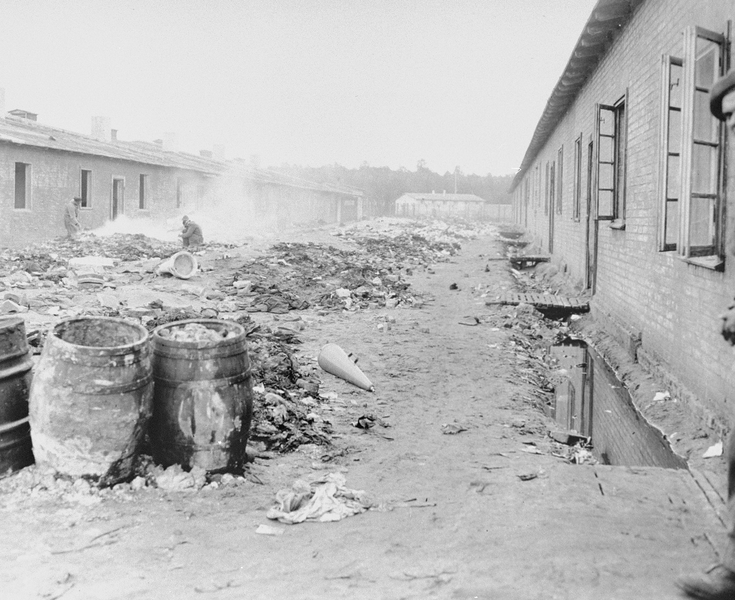 A refuse-filled yard between barracks in Bergen-Belsen concentration camp.