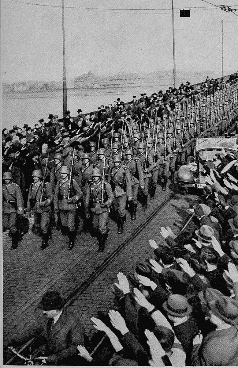 German troops cross the Rhine river during the re-militarization of the Rhineland.