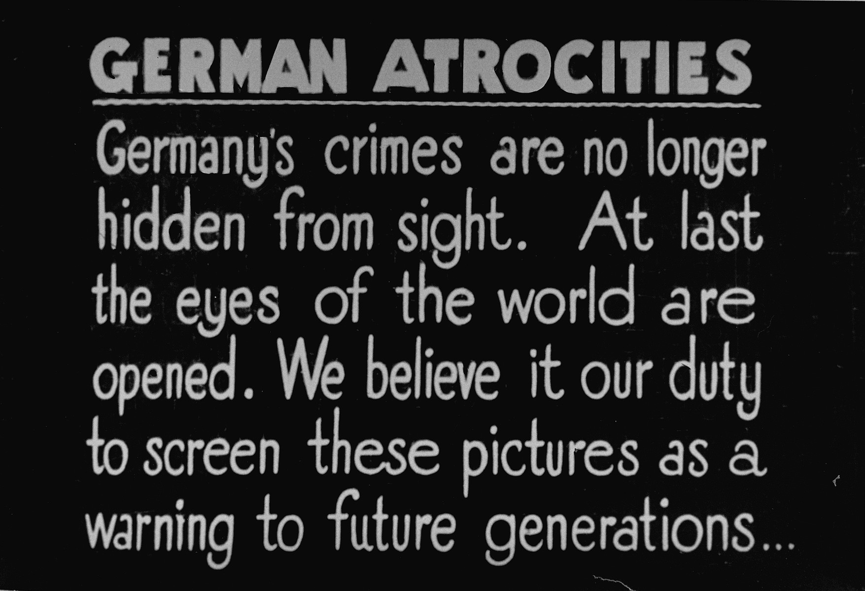 A British Army sign that was posted with a photo display intended to show German civilians from surrounding towns the atrocities committed in Bergen-Belsen concentration camp.