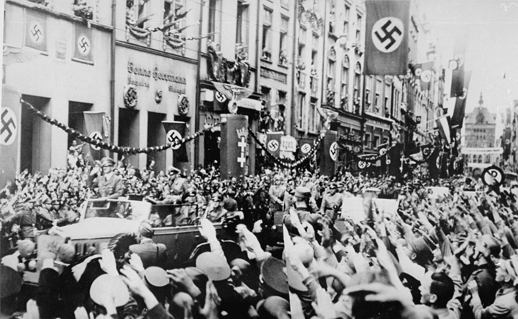 Saluting Germans greet Adolf Hitler during his visit to Danzig.