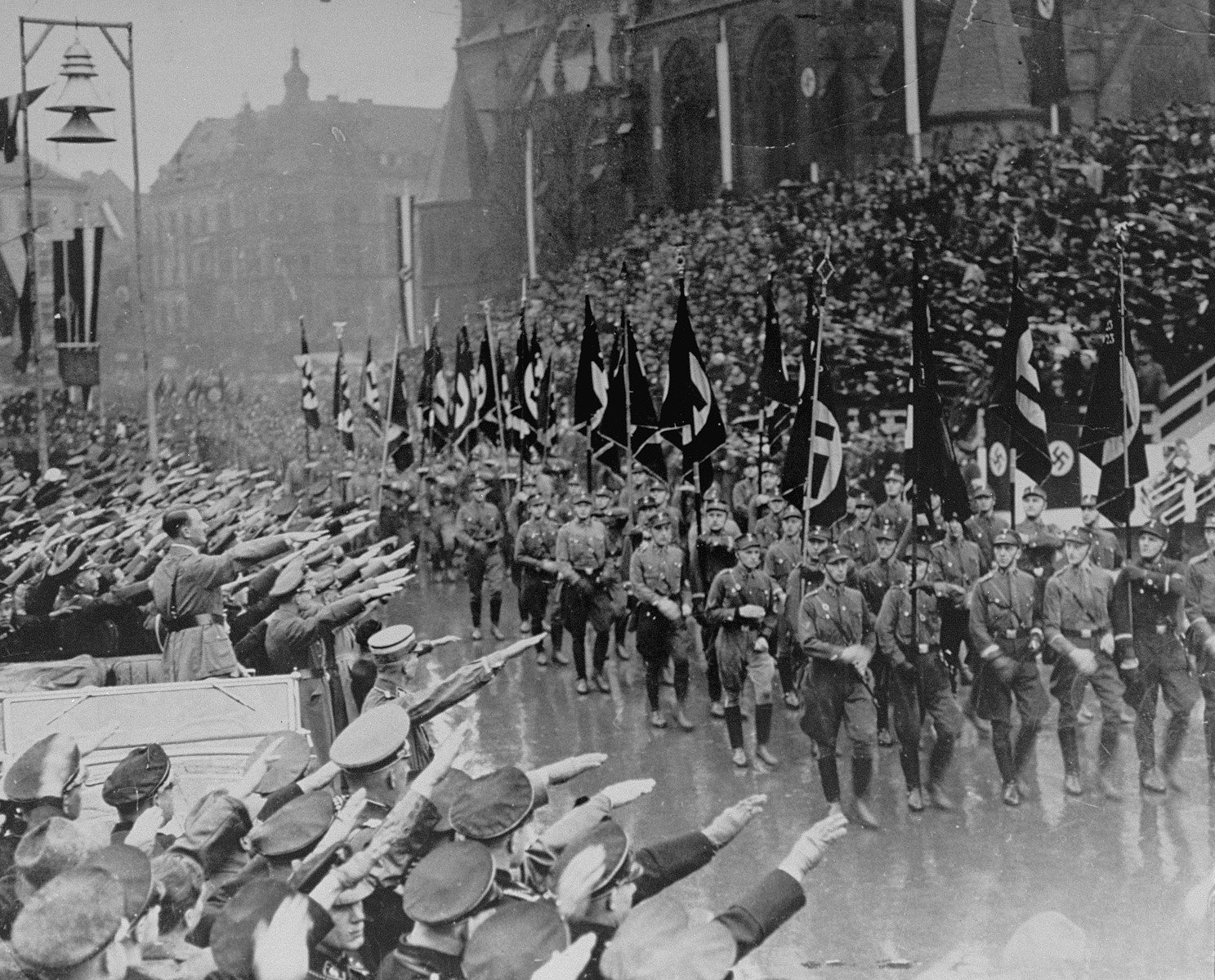 Hitler reviews SA troops during a parade in Saarbruecken.    Saarlanders gave Hitler an enthusiastic welcome when he made his dramatic entry into the Saar for its official transfer from the League of Nations to Germany.