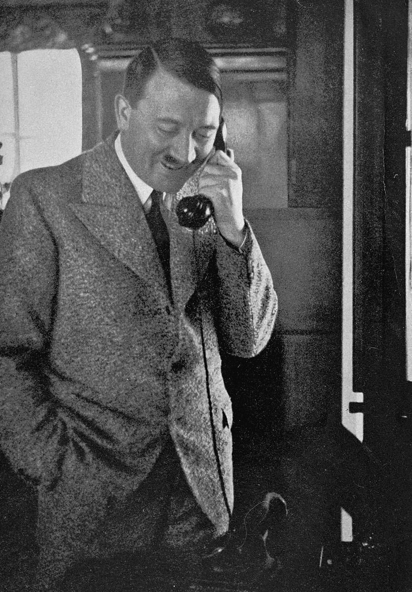 Adolf Hitler speaks on the telephone with Gauleiter Joseph Buerckel after the Saar plebiscite determined that the region would remain a part of Germany.