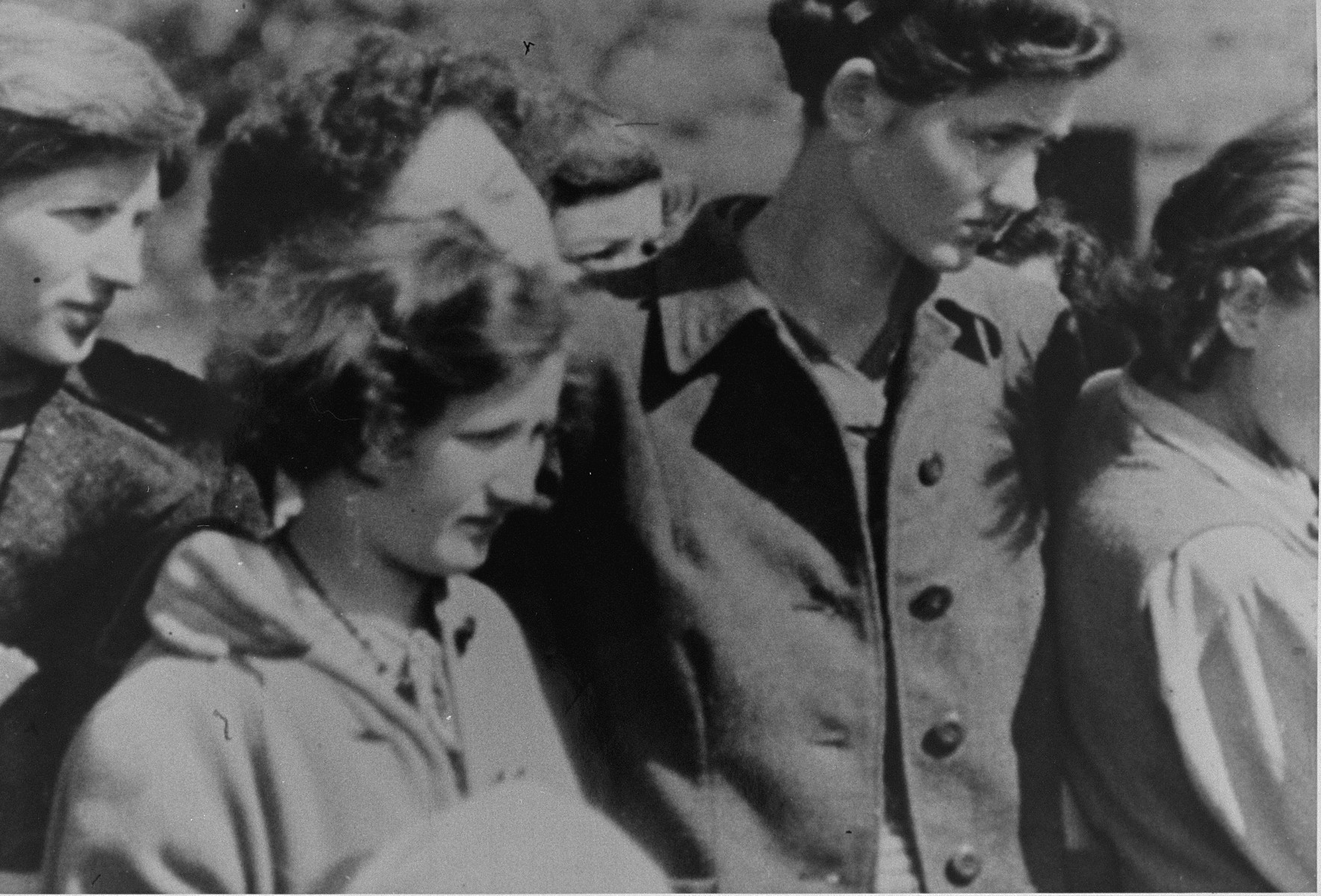 Young men and women from the surrounding villages are confronted with the atrocities committed by Germans in Bergen-Belsen concentration camp.