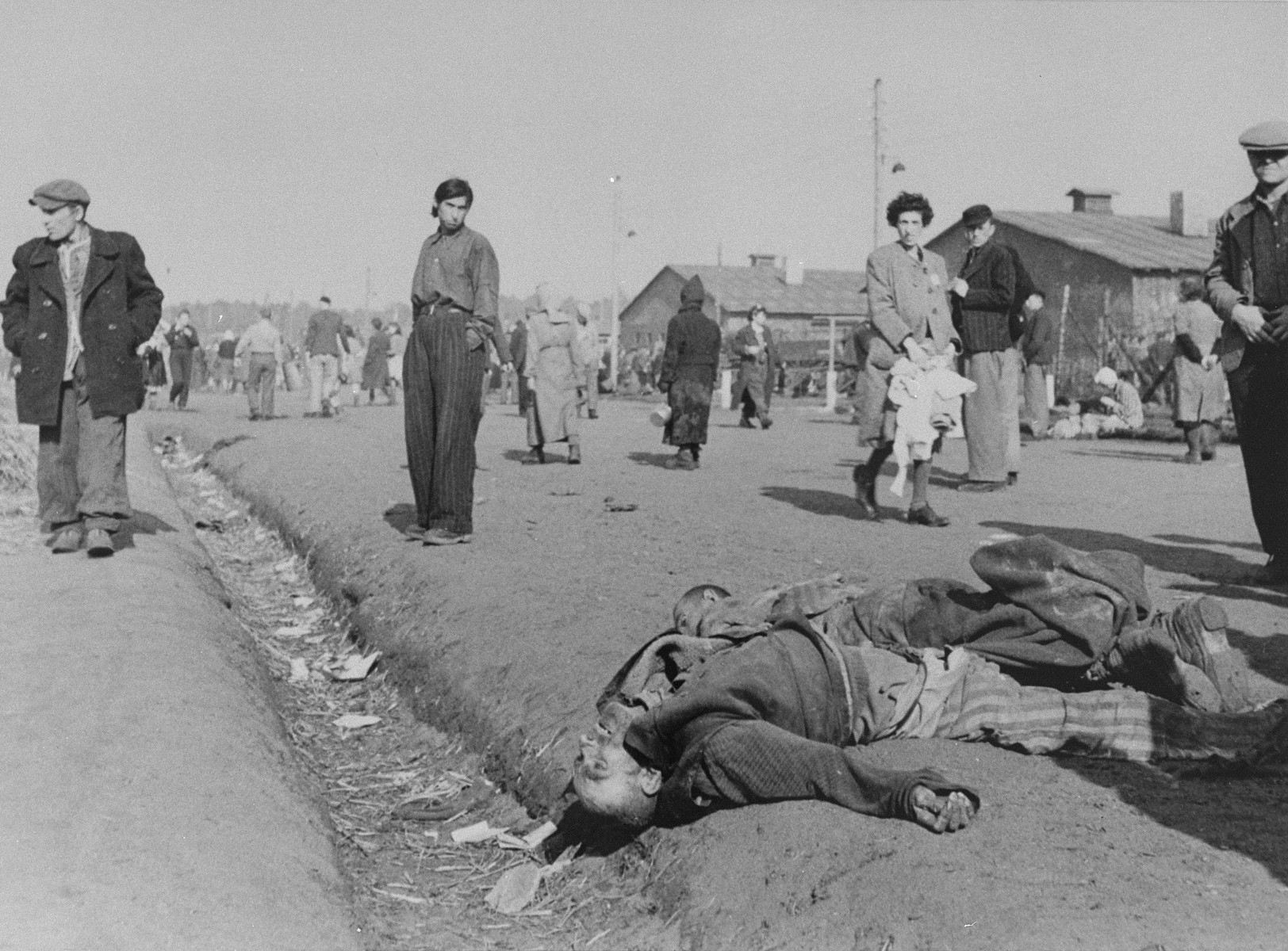 Corpses lying amongst survivors in Bergen-Belsen.