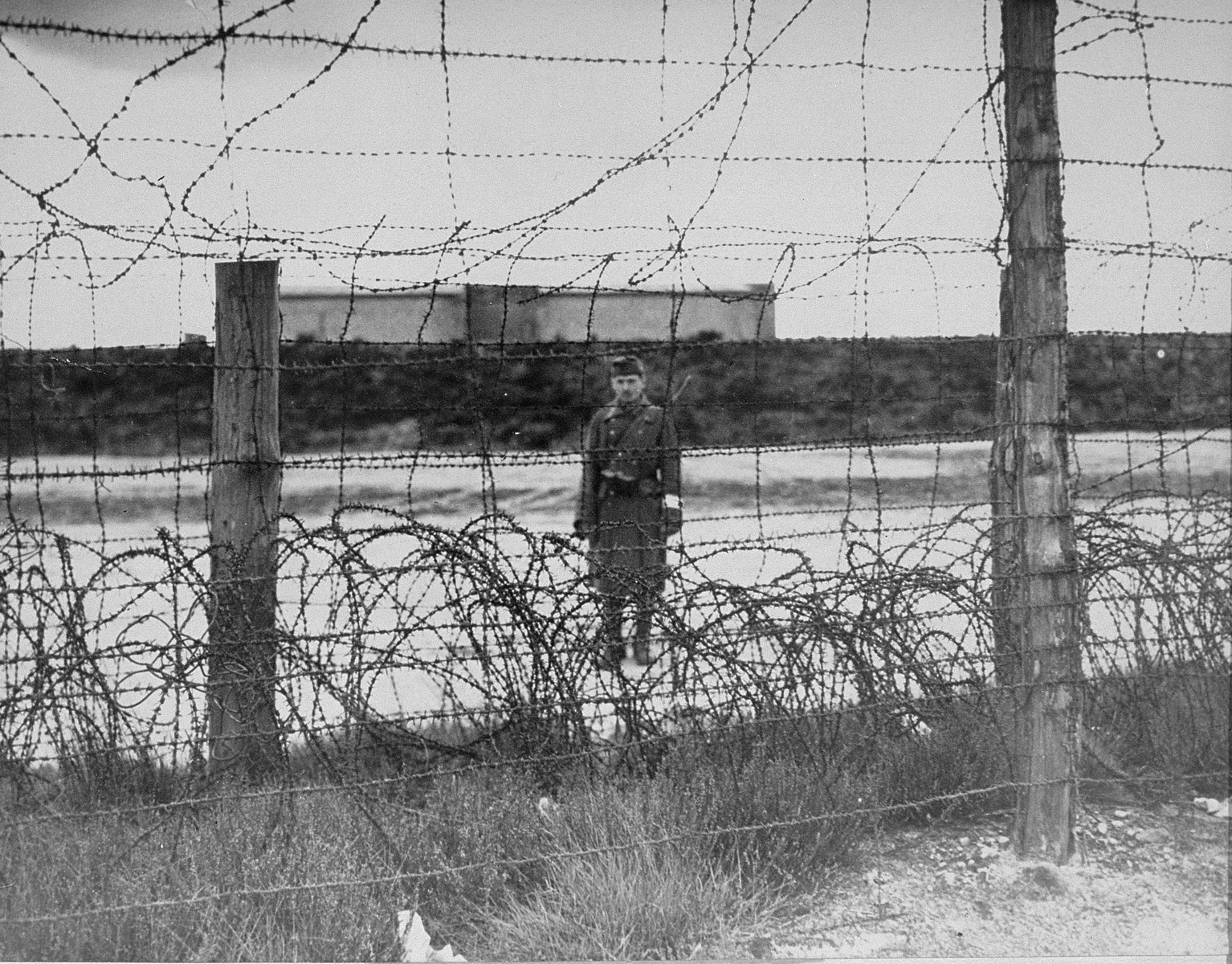 A Hungarian sentry guarding the perimeter at Bergen-Belsen concentration camp.