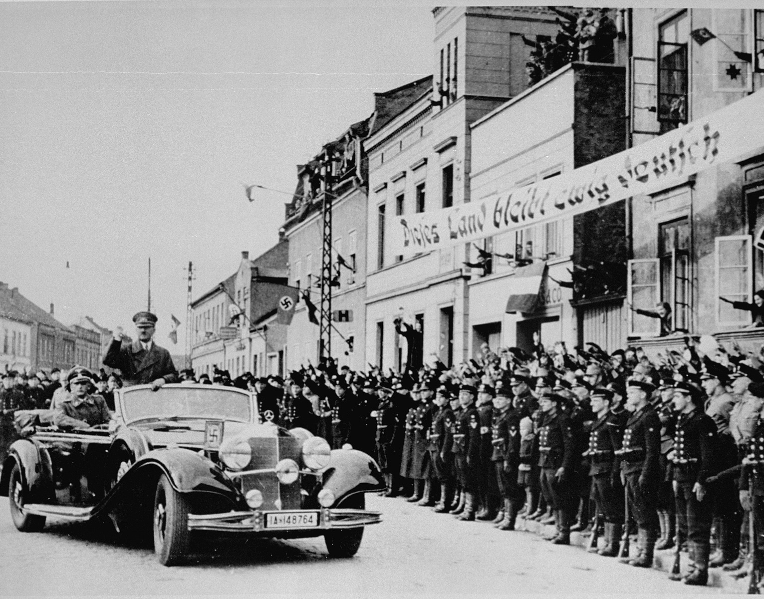 Adolf Hitler arrives in Memel the day after the city's annexation to the Reich.  A part of East Prussia since the 16th century, Memel and its environs were removed from Germany in 1919 and annexed to Lithuania in 1923 as as autonomous area.  However, after 1933, Hitler agitated for it to be returned to the Reich and the Nazi Party gradually seized control of local politics through the faction controlled by Dr. Ernst Neumann.  Germany eventually annexed Memel and its forces entered the region and city on 22 March 1939.  Most of the Lithuanian and Jewish population fled the city before the German takeover.