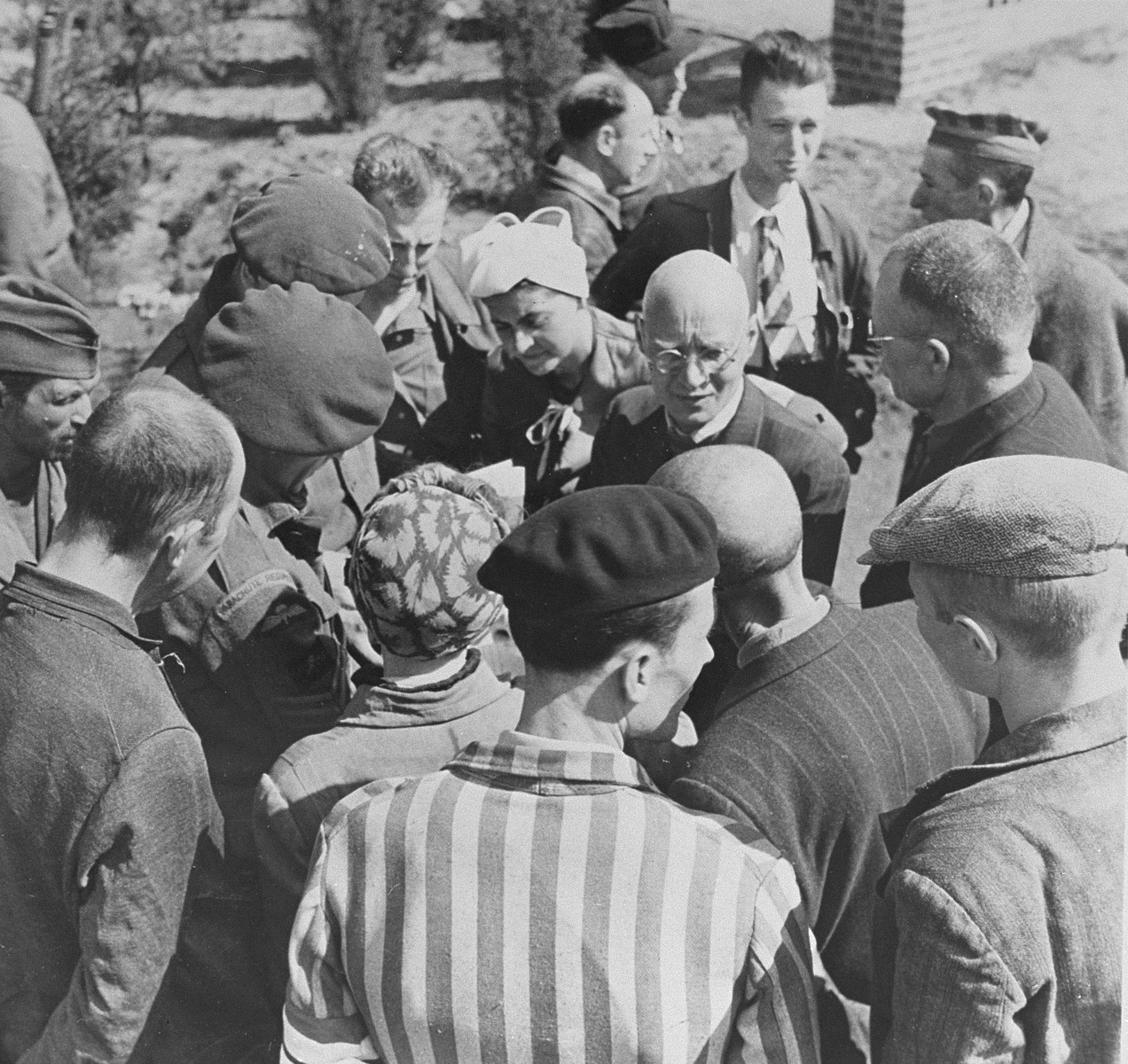 The mayors of nearby towns speak to survivors in Bergen-Belsen concentration camp.