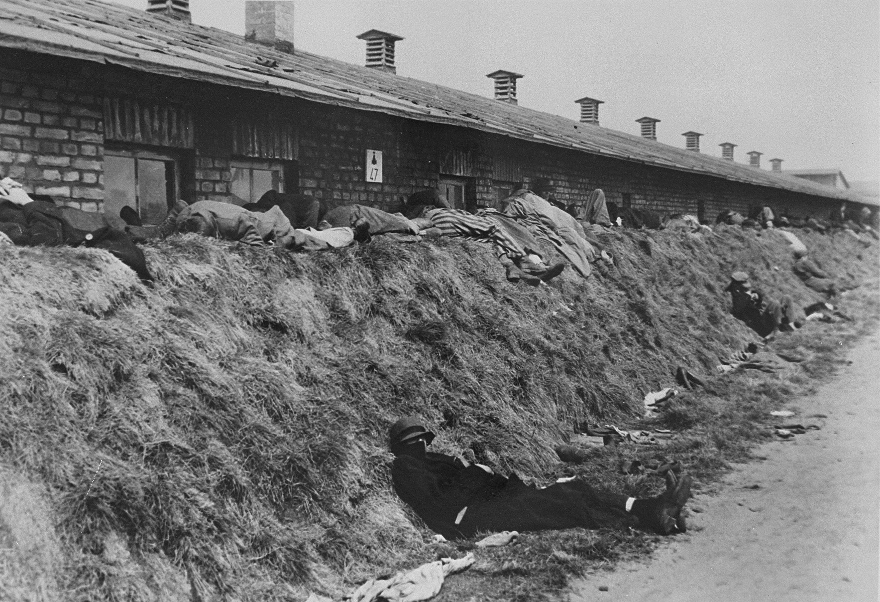 The living sleep among the dead outside of a barrack in Bergen-Belsen.
