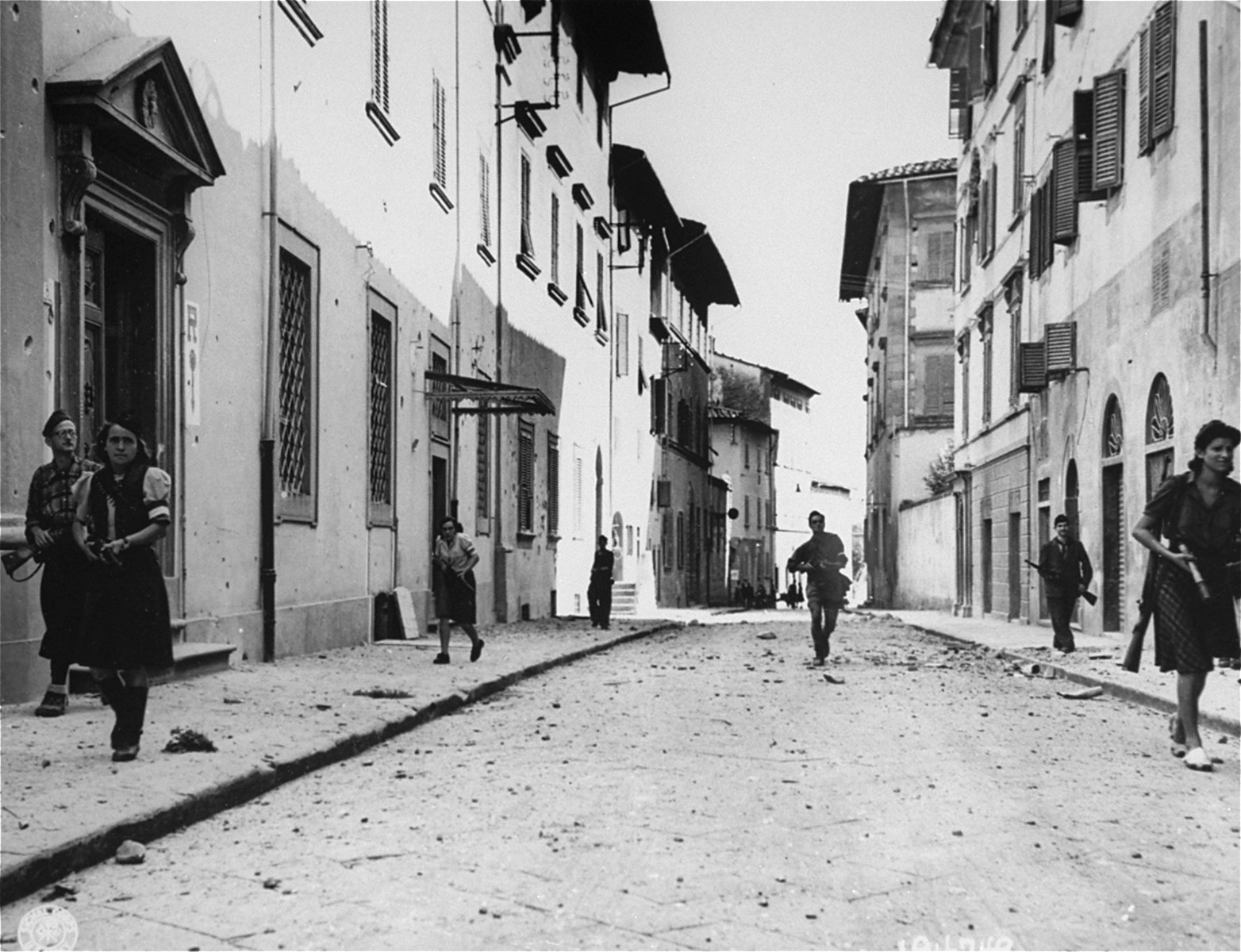 French partisans patrol the streets of an unidentified town during the insurrection in southern France.
