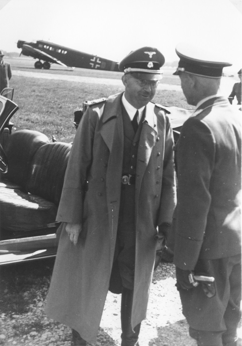 Reichsfuehrer-SS Heinrich Himmler greeting an unidentified person [probably at the airport in Paderborn].