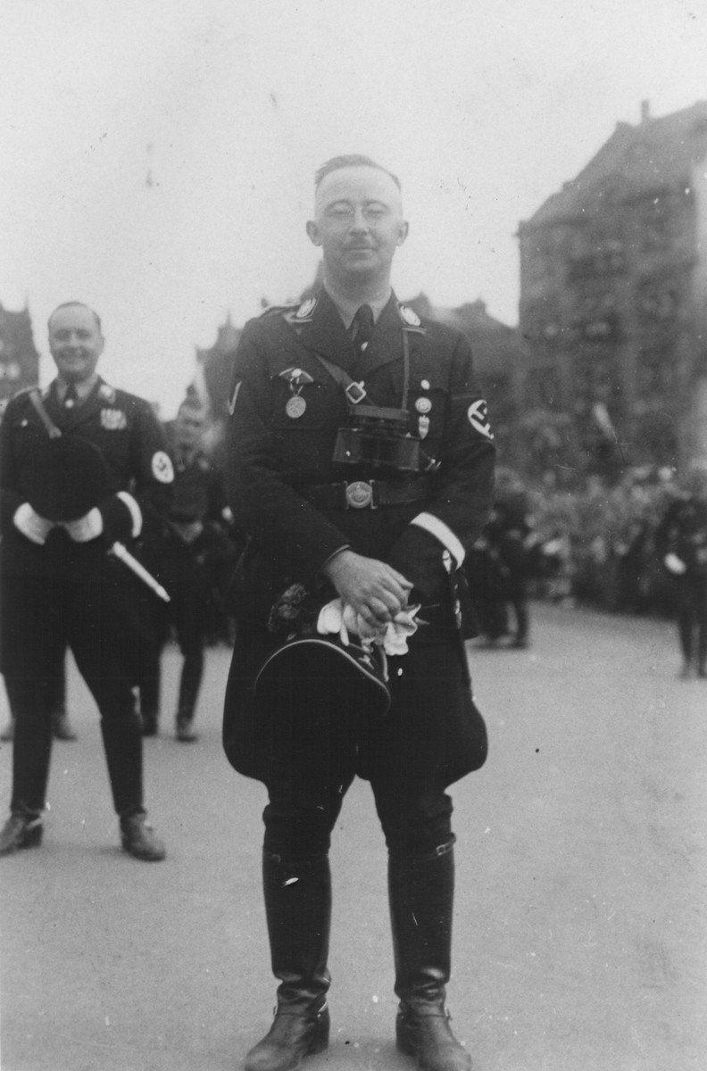 Portrait of Reichsfuehrer-SS Heinrich Himmler during a Reichsparteitag (Reich Party Day) parade in Nuremberg.  Behind Himmler is his adjutant, Karl Wolff.