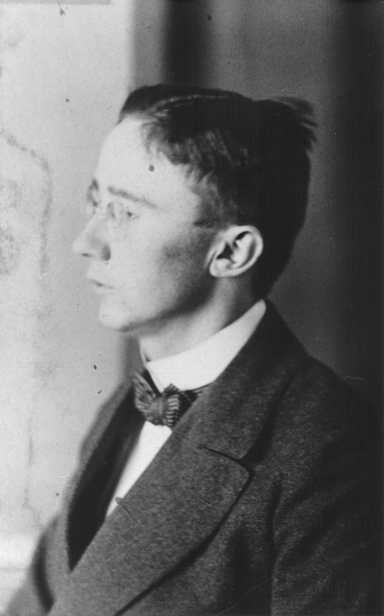 Profile of a young Heinrich Himmler wearing a jacket and bow tie.