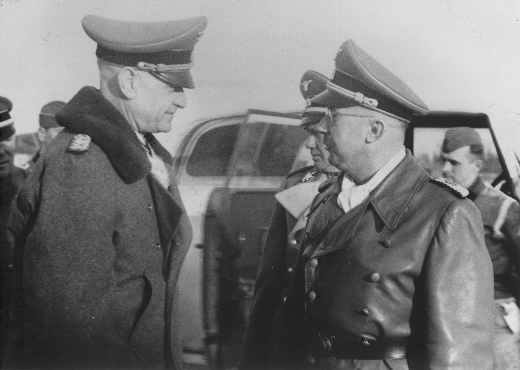 Reichsfuehrer-SS Heinrich Himmler converses with SS-Obergruppen Fuehrer Alfred Wunnenberg.  Pictured to Himmler's immediate right Friedrich Jeckeln.