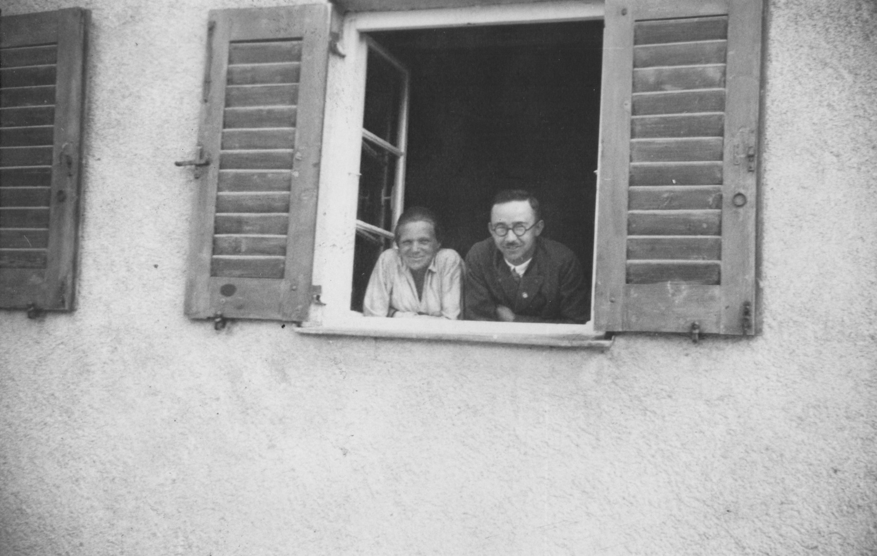 Heinrich and Margarete Himmler look out the window of their home on their chicken farm in Waldtrudering near Munich.