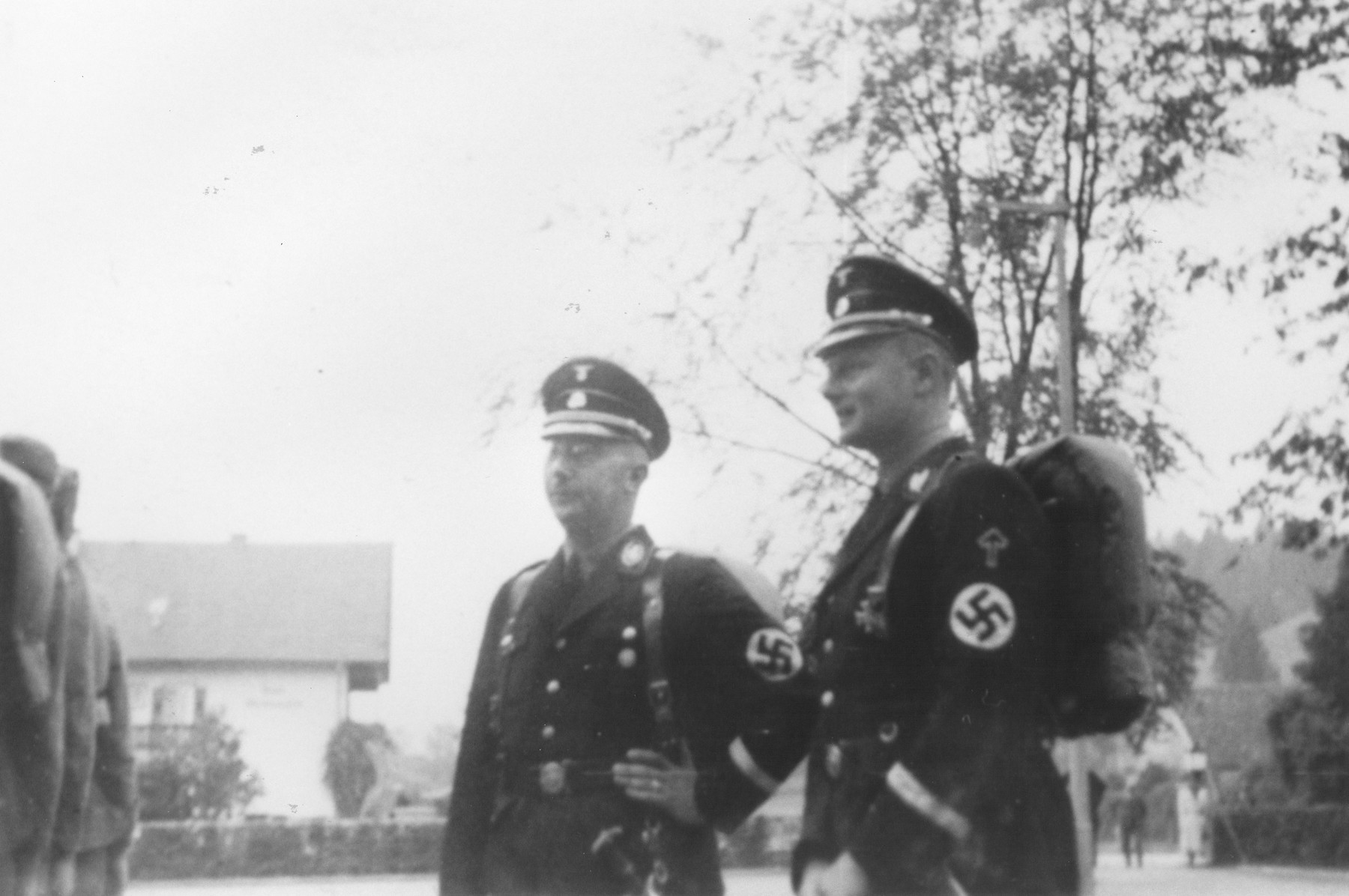Reichsfuehrer-SS Heinrich Himmler stands outside with Karl Wolff.