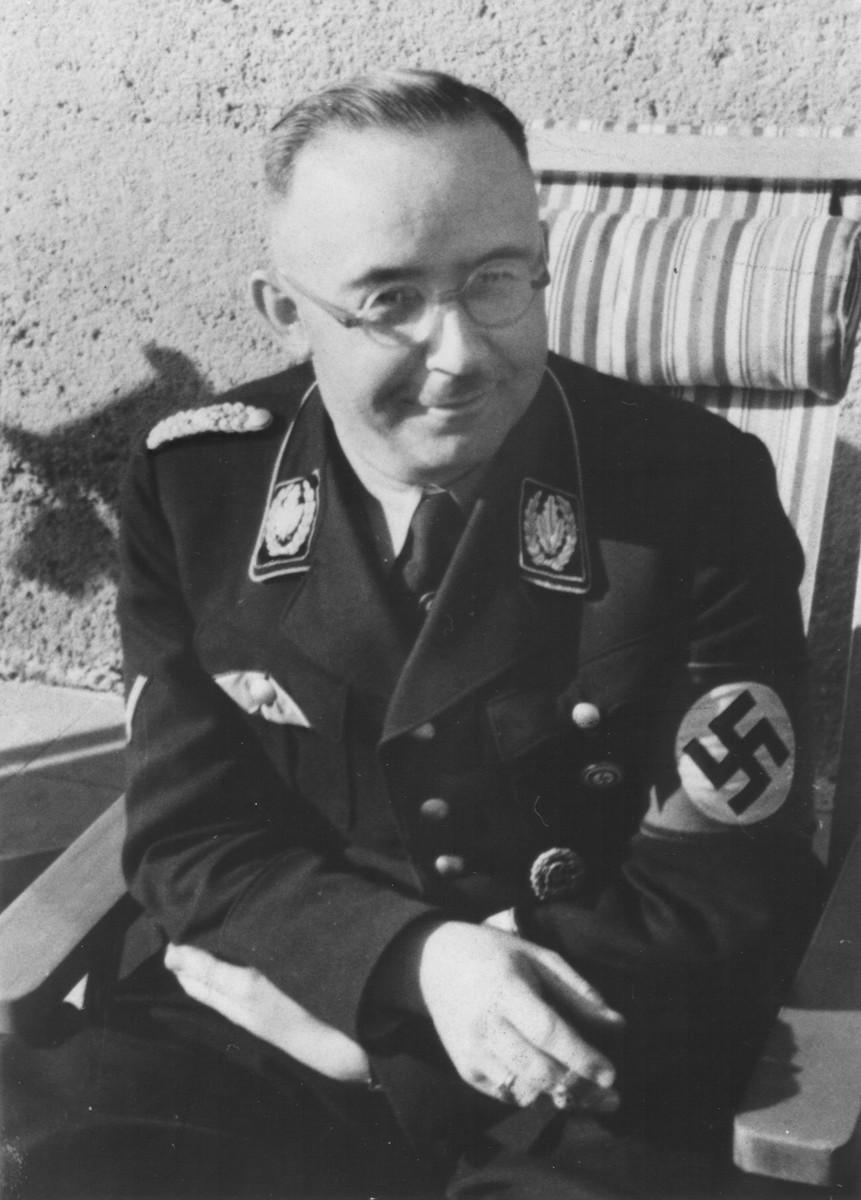 Portrait of Reichsfuehrer-SS Heinrich Himmler seated on a lawn chair.