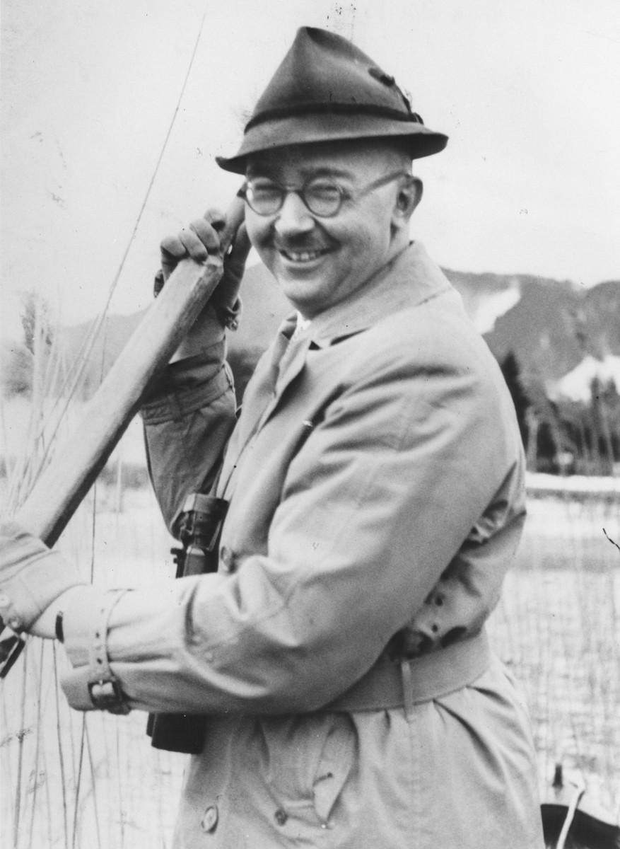 Heinrich Himmler poses in a boat holding an oar.