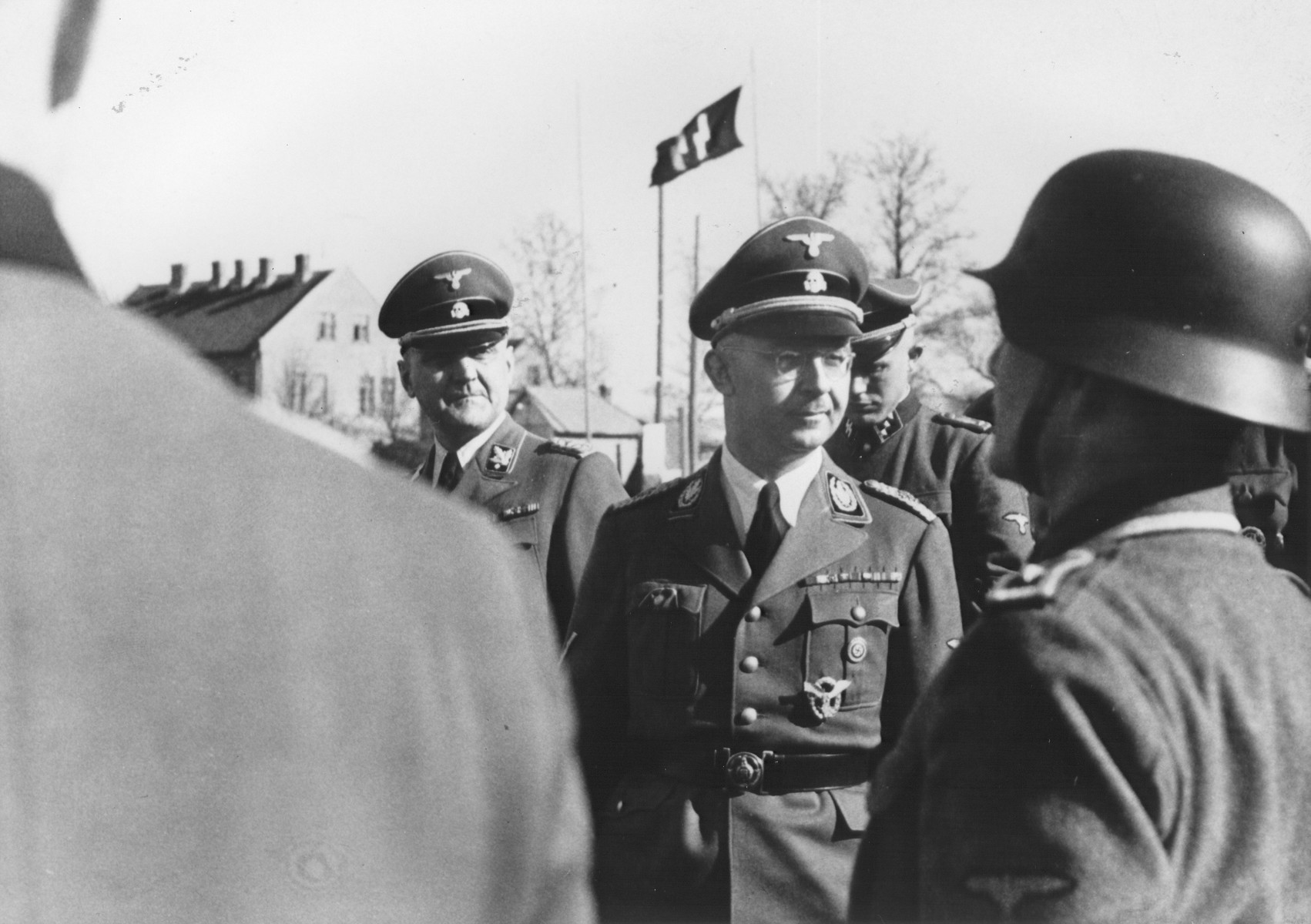 Reichsfuehrer-SS Heinrich Himmler [probably reviewing a unit of SS troops].  Pictured to the left of Himmler is Gottlob Berger.