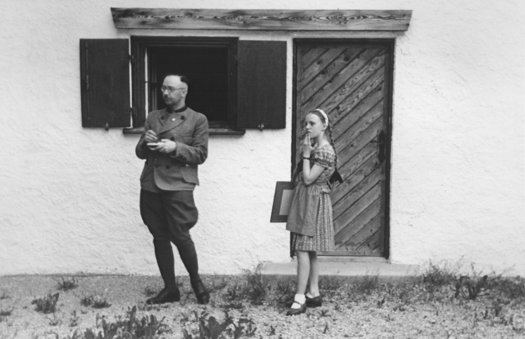 Heinrich Himmler with his daughter Gudrun in front of their home in Gmund am Tegernsee.