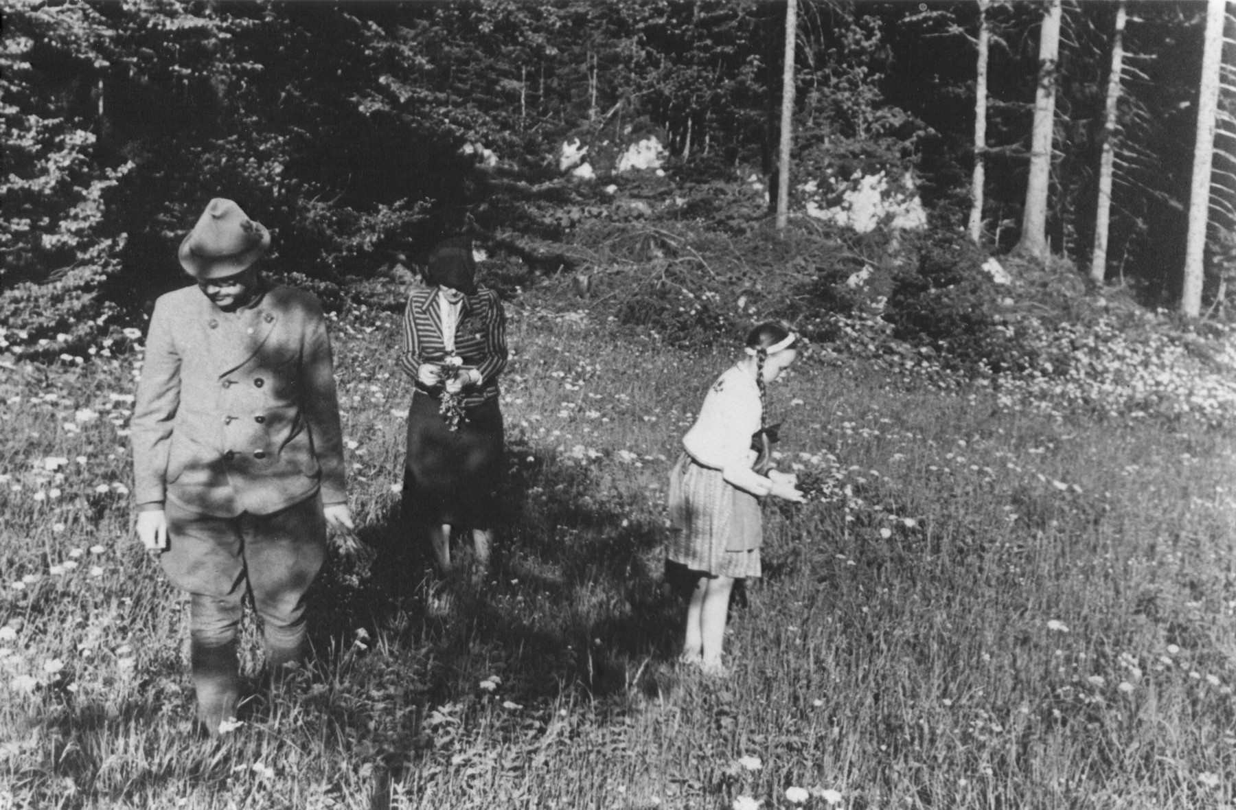 Heinrich Himmler collects wild flowers with his daughter Gudrun and his wife Margarete.