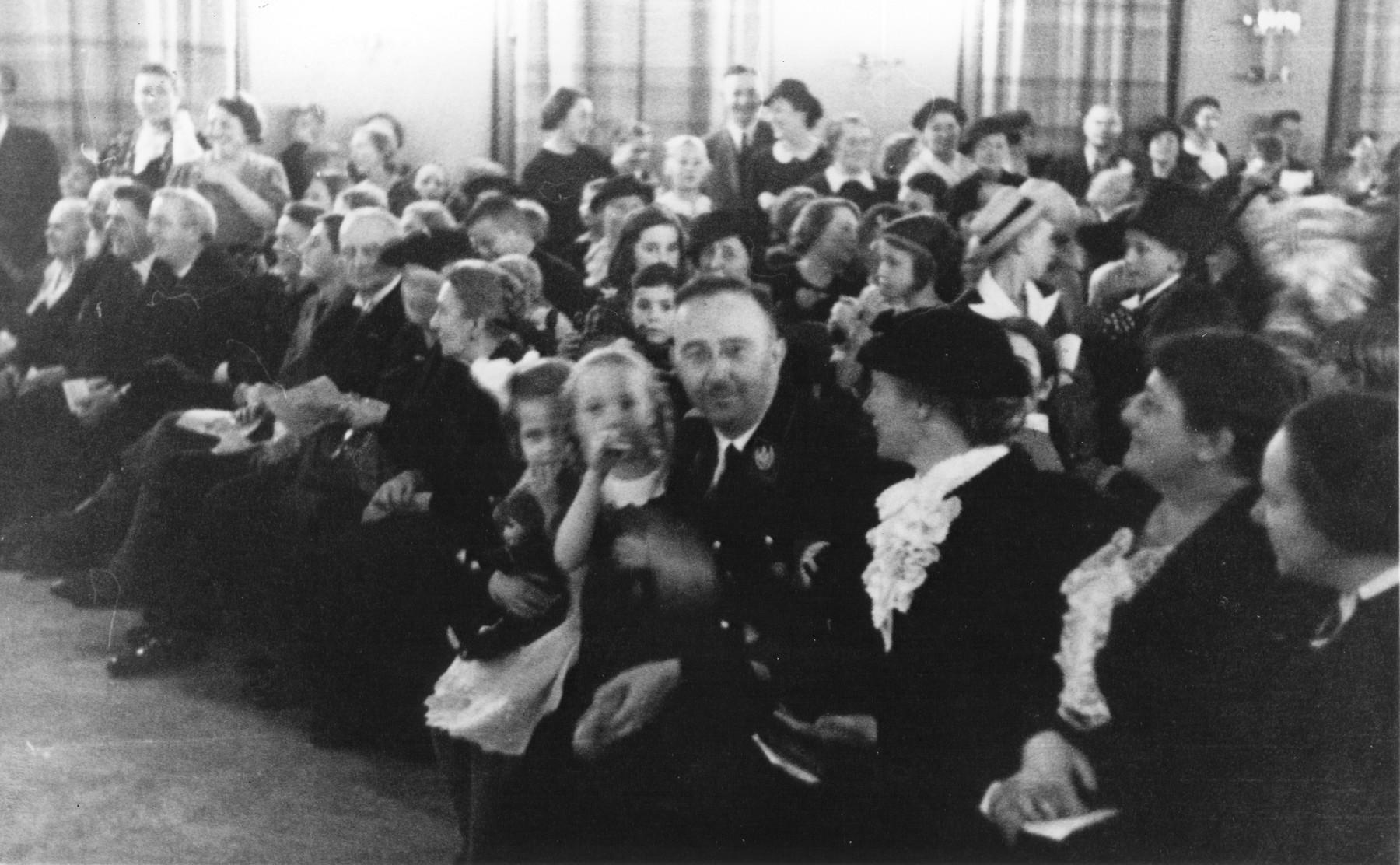 Reichsfuehrer-SS Heinrich Himmler holding his daughter Gudrun at a function at her elementary school in Berlin-Dahlem.