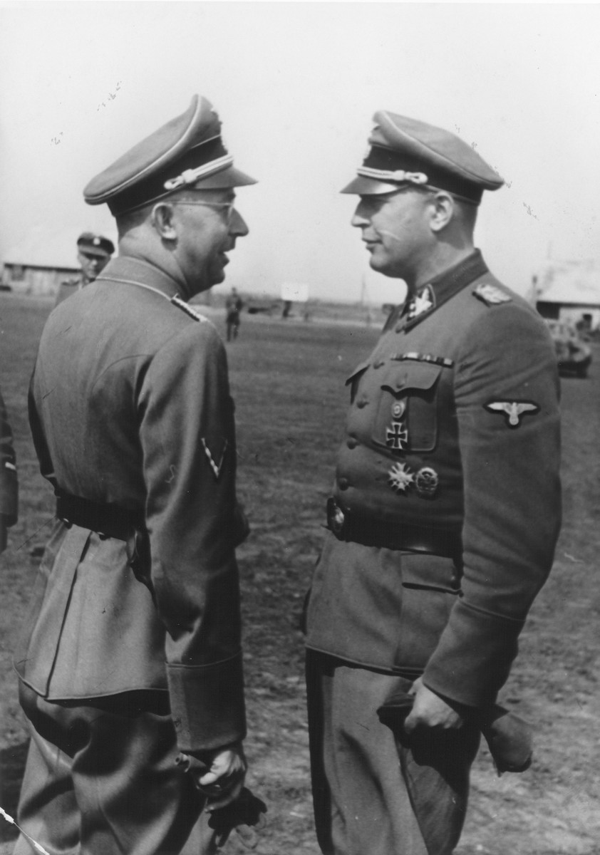 Reichsfuehrer-SS Heinrich Himmler (left) confers with SS and Police Leader Hans Adolf Pruetzmann (right) [probably during Himmler's visit to the Waffen SS Armored Division Wiking].