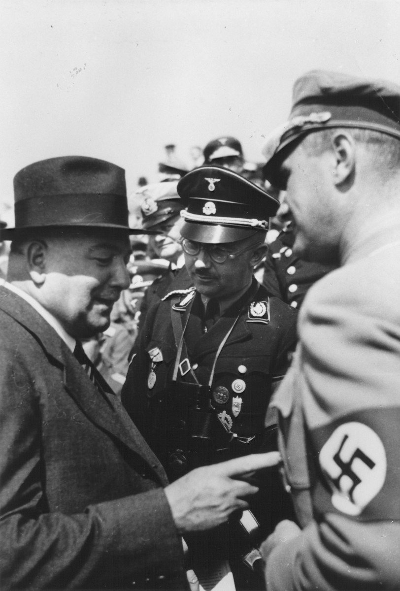 Heinrich Himmler (center) with Constantin Freiherr von Neurath (left) and the man on the right has been identified as either Fritz Wiedemann or Rudolf Hess at a Reichsparteitag (Reich Party Day) rally in Nuremberg.