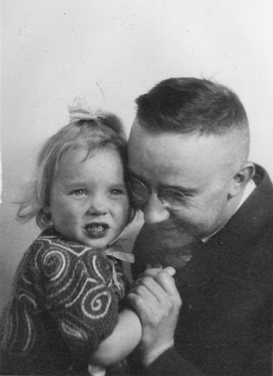 Portrait of Heinrich Himmler with his daughter Gudrun.