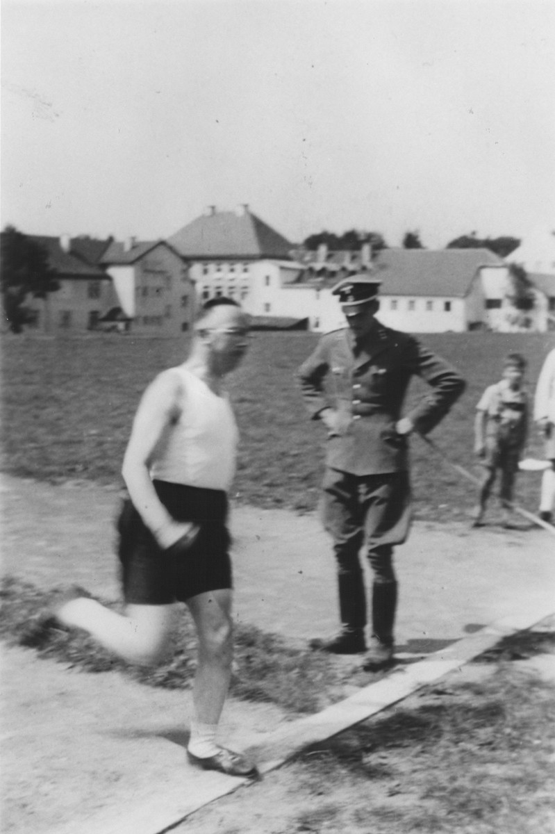 Heinrich Himmler runs across the finish line on an outdoor track at the SS officers school in Bad Tolz, Germany.