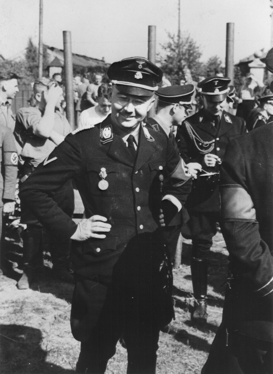 Reichsfuehrer-SS Heinrich Himmler poses outside among other SS officers.  Pictured at the right is Karl Wolff.
