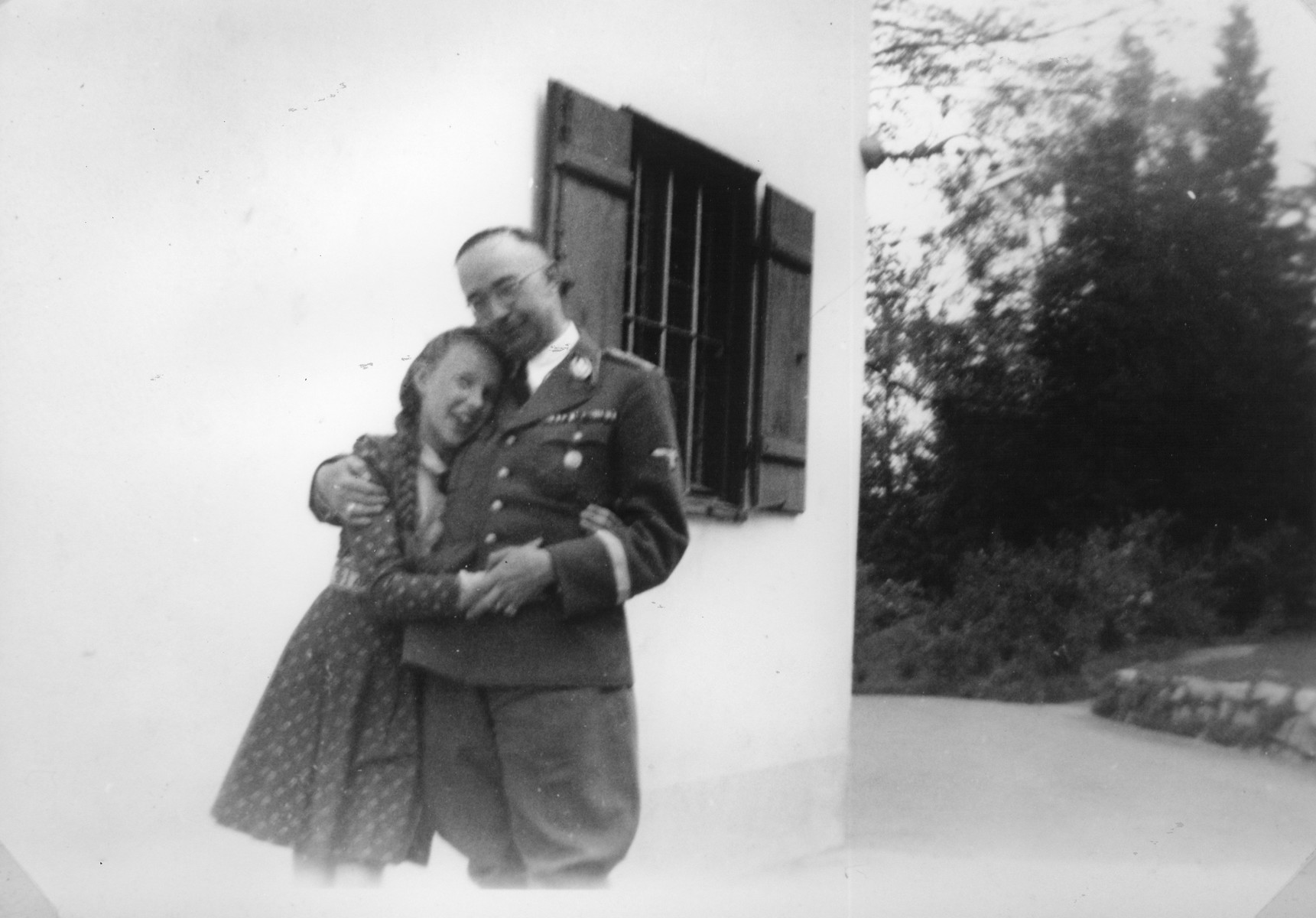 Reichsfuehrer-SS Heinrich Himmler embraces his daughter Gudrun [probably outside their home in Gmund am Tagernsee].