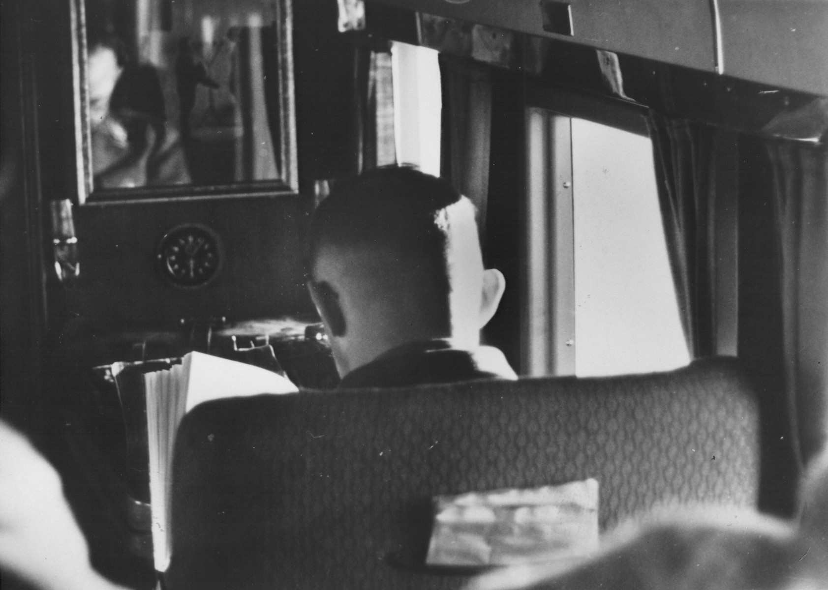 Reichsfuehrer-SS Heinrich Himmler reading in a private compartment of a plane or train.