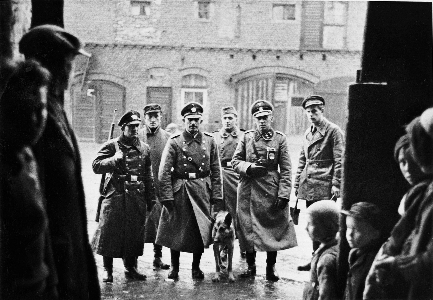 "A group of SS, police, and ethnic German auxilliaries prepare to conduct a search during the ""pacification"" of Bydgoszcz in the opening months of the war."