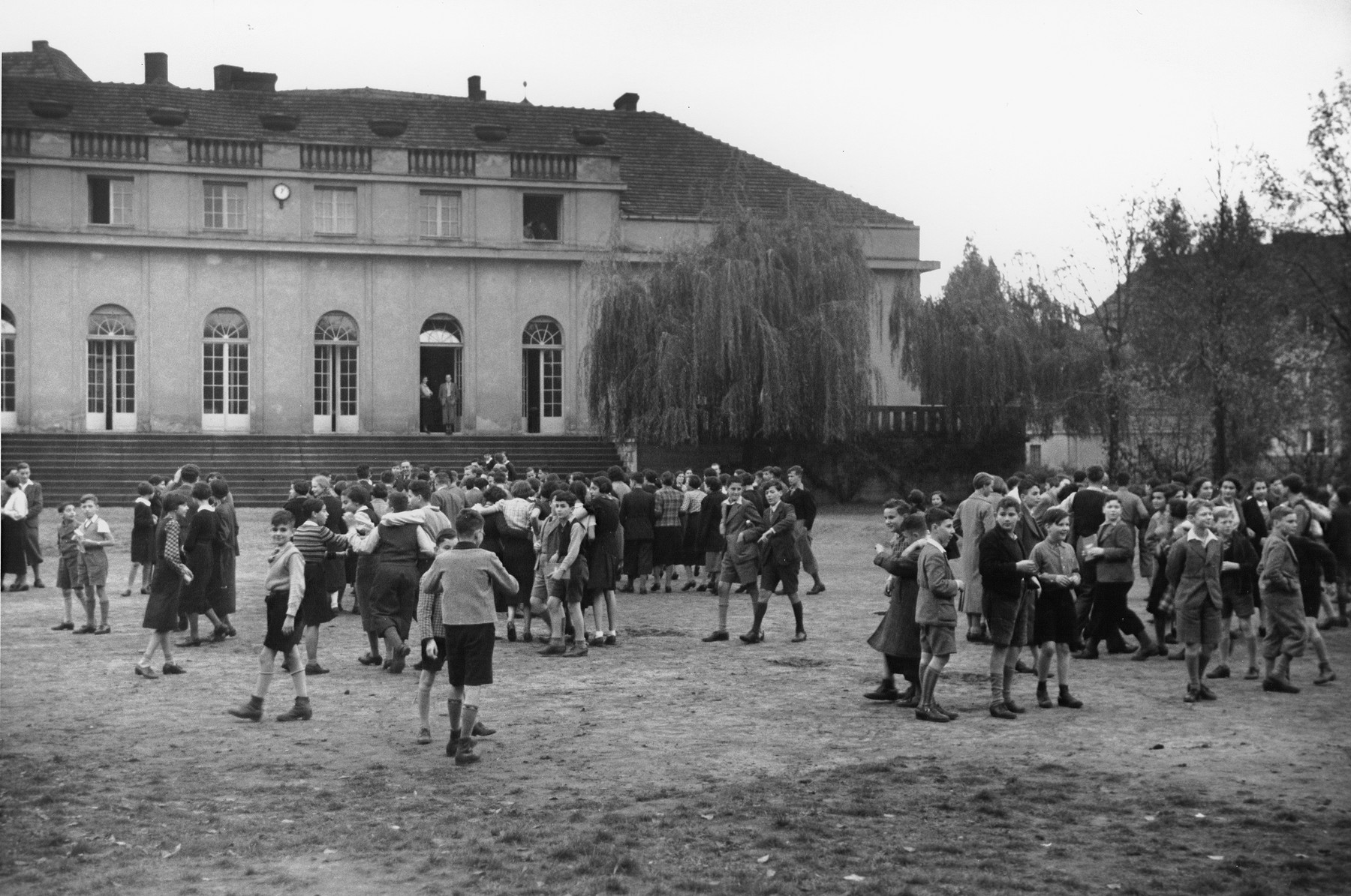 Teenage boys and girls stand outside on the grounds of the Goldschmidt Jewish private school in Berlin-Grunewald.