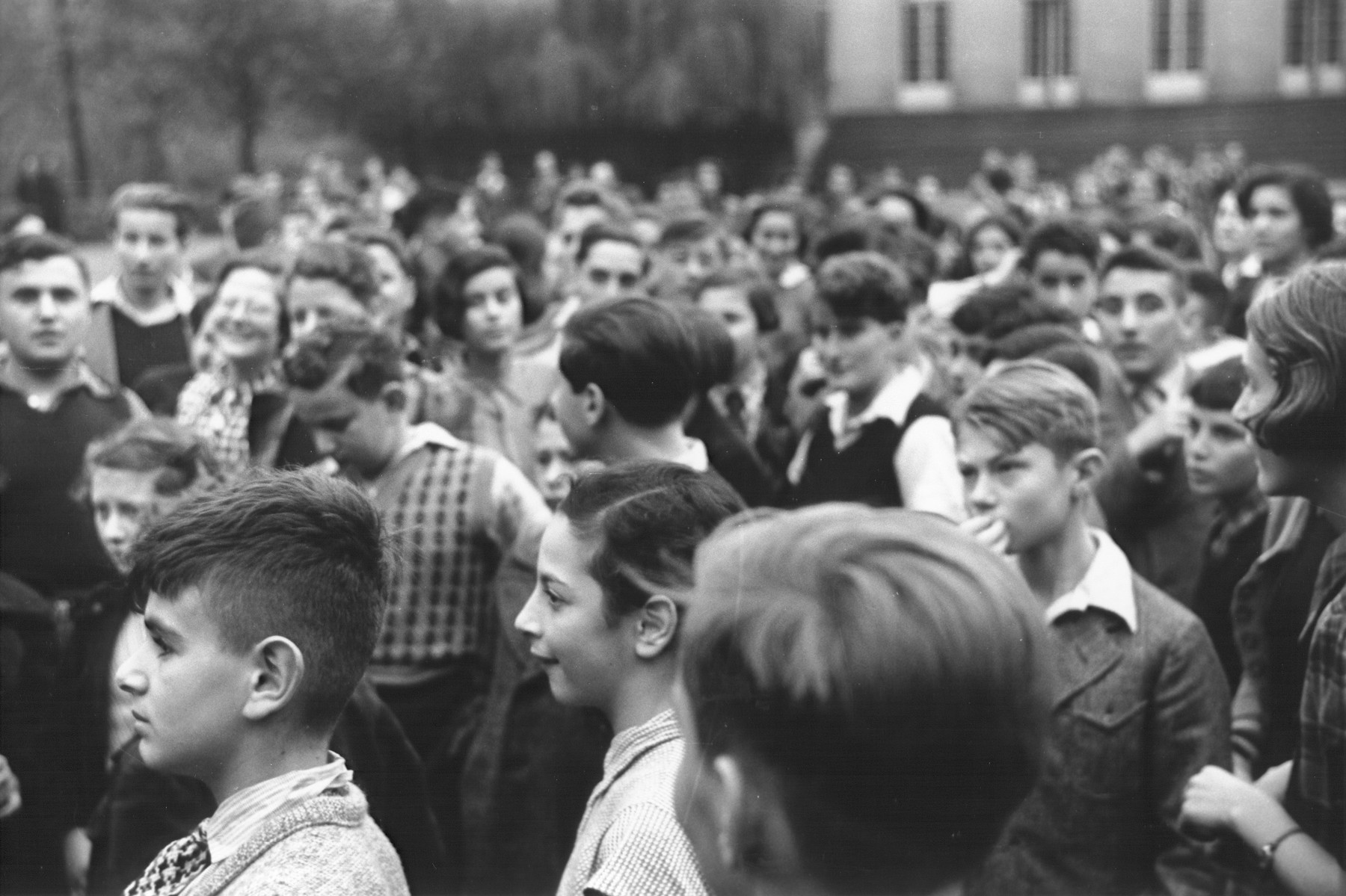 A crowd of teenage students are gathered outside on the grounds of the Goldschmidt Jewish private school in Berlin-Grunewald.