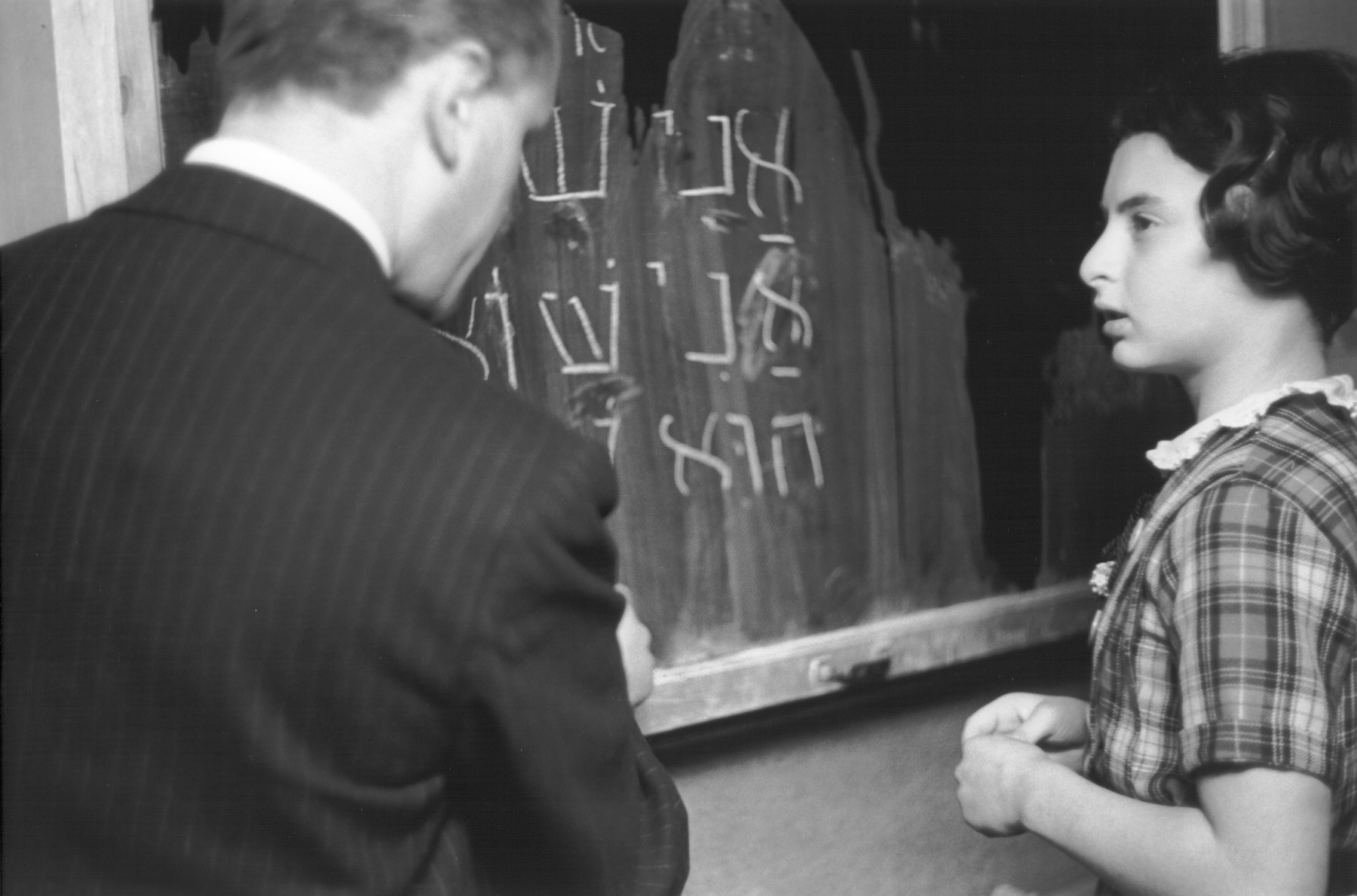 A Hebrew teacher at the Goldschmidt Jewish private school in Berlin-Grunewald instructs a pupil at the chalkboard.