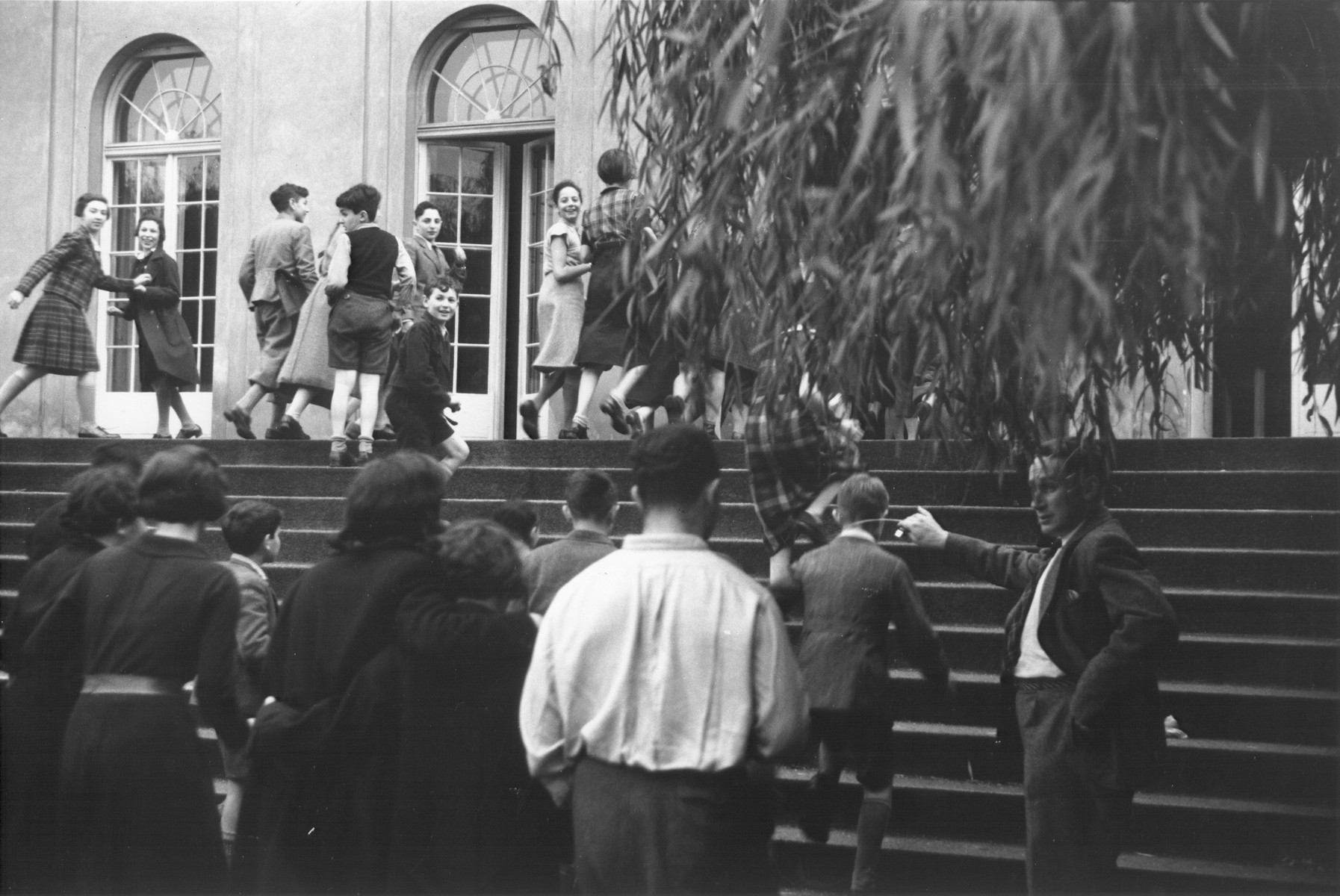 Teenage students ascend the steps to the villa housing the Goldschmidt Jewish private school in Berlin-Grunewald.